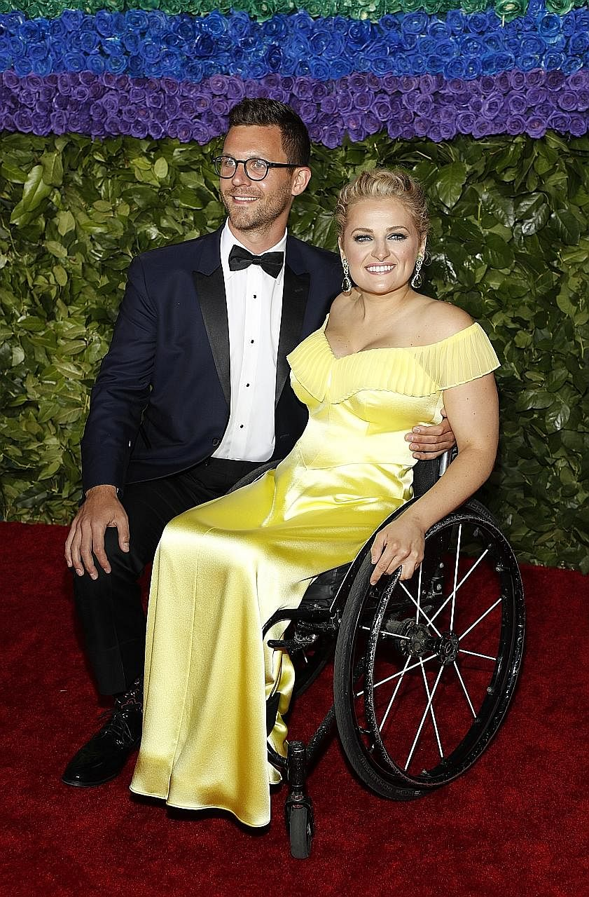 Ali Stroker (above), with boyfriend David Perlow, won the Tony for best supporting actress in a musical for her role as Ado Annie in the revival of Rodgers & Hammerstein's Oklahoma!. Actress Marisa Tomei (right), who was one of the presenters at the