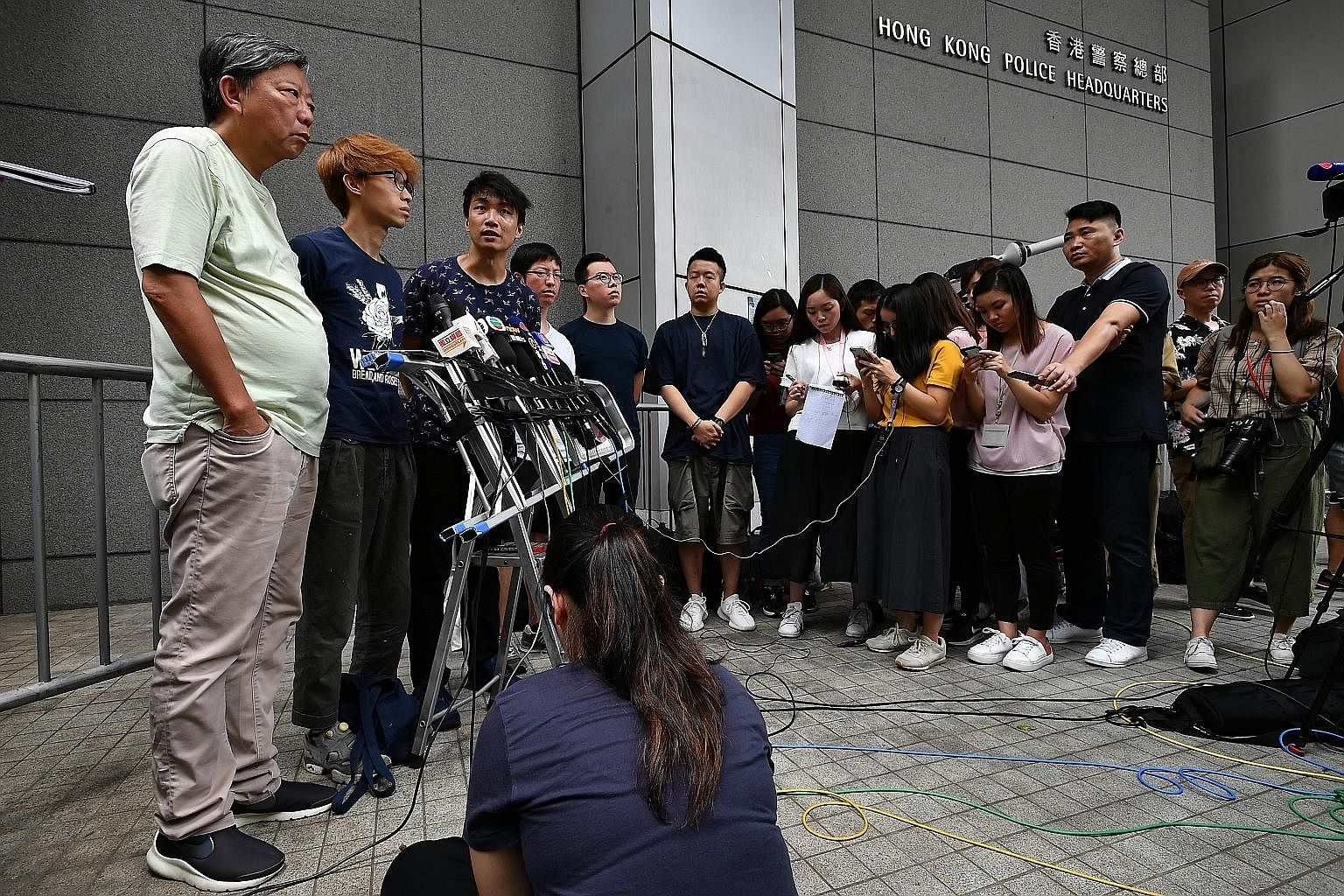 (From left) Hong Kong's Civil Human Rights Front representatives Lee Cheuk-yan, Figo Chan, Jimmy Sham and Wong Yik-mo holding a press conference before making an official complaint against the excessive use of force by the police against protesters o