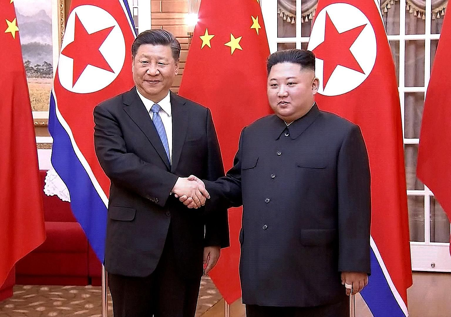 Chinese President Xi Jinping with North Korean leader Kim Jong Un in Pyongyang yesterday, in this screengrab taken off a video released by China's state broadcaster CCTV.