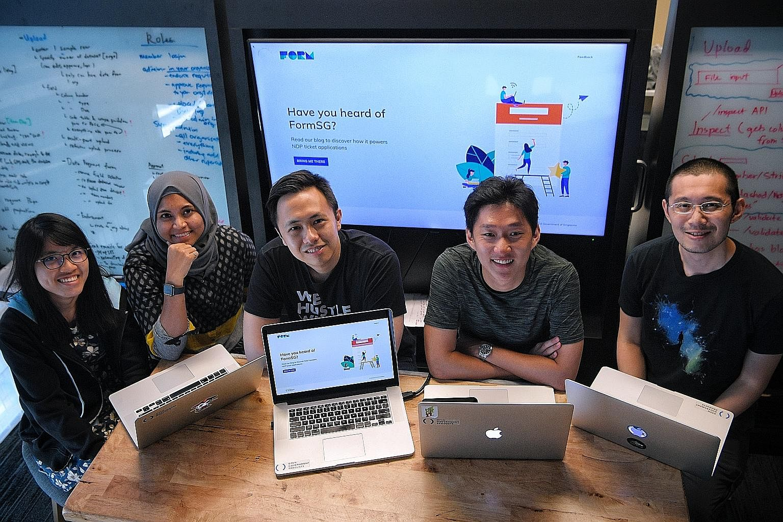 The team behind FormSG (from left) includes software engineer Jean Tan, 26; UX designer Sarah Salim; product manager Leonard Loo; software engineer Yuanruo Liang, 29; and Open Government Products head Li Hongyi.