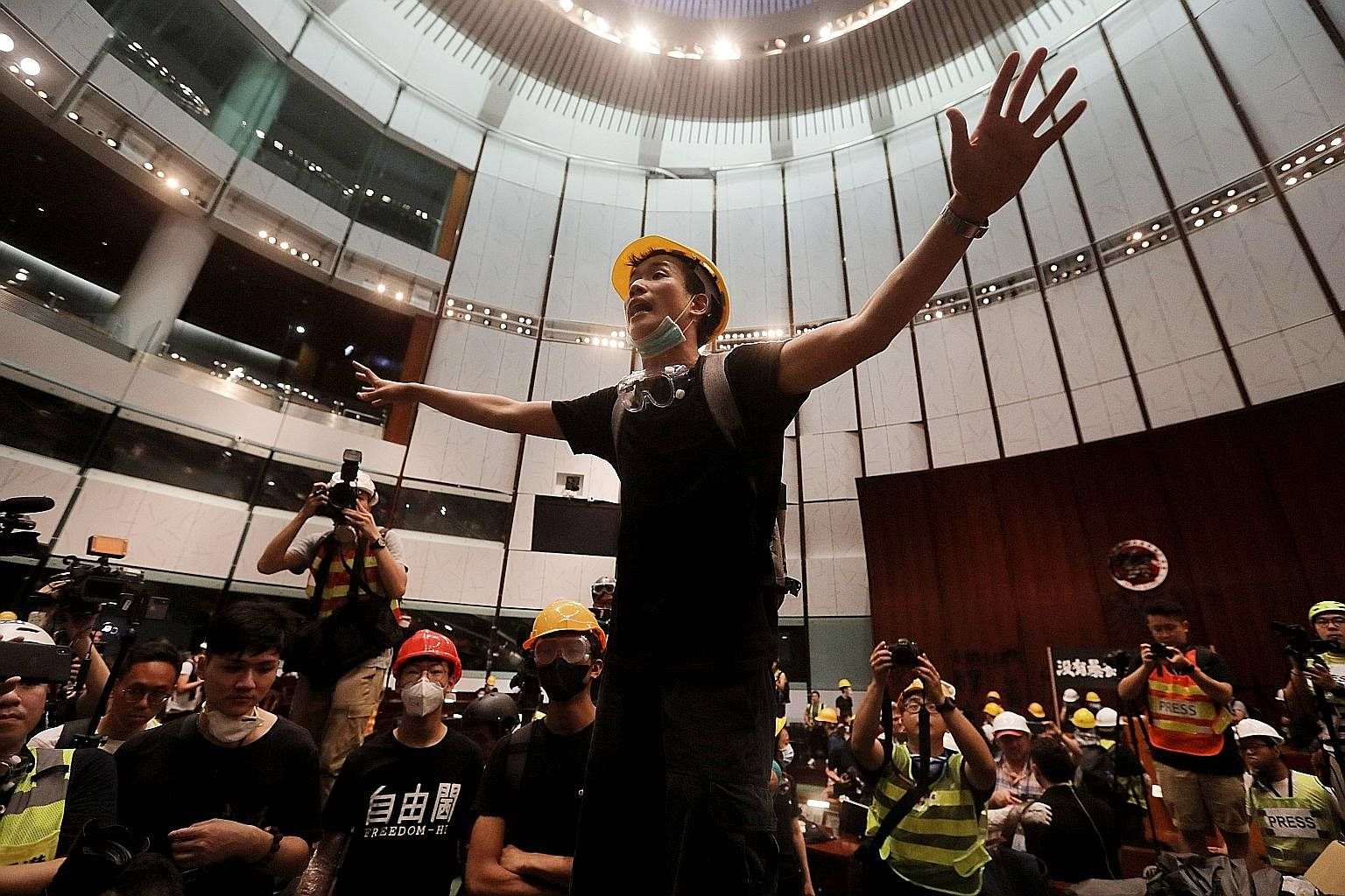 Protesters holding placards and strips of cloth with protest messages at last Friday's rally. But discontent had already reared its head during the Occupy Movement in 2014. The protesters broke into the Parliament chambers of the Legislative Council