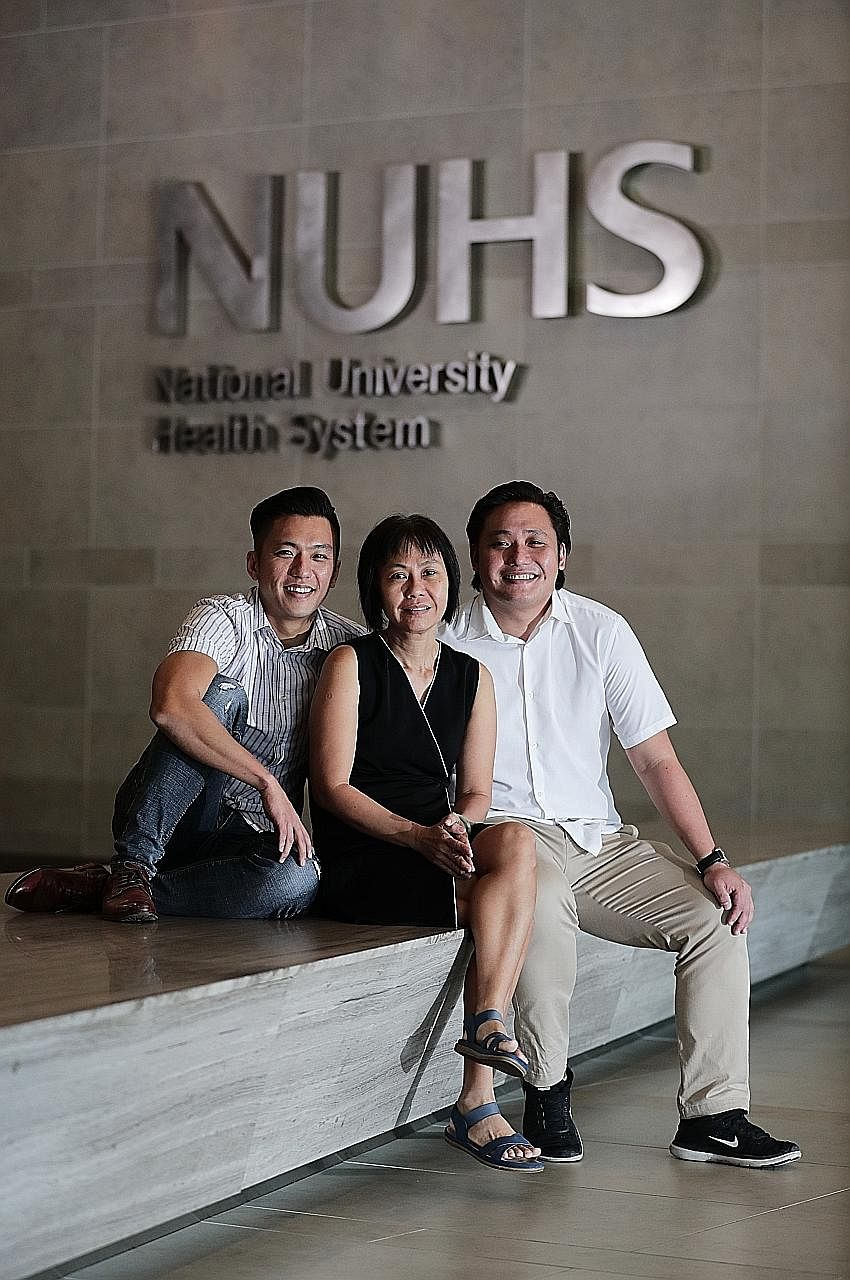 Brothers Lin Hanwei (far left) and Dilun share a special bond - both have given strangers the gift of life. In May, older brother Hanwei, 35, answered an online appeal and gave a part of his liver to Mr Eddie Tan, who had end-stage liver disease. He