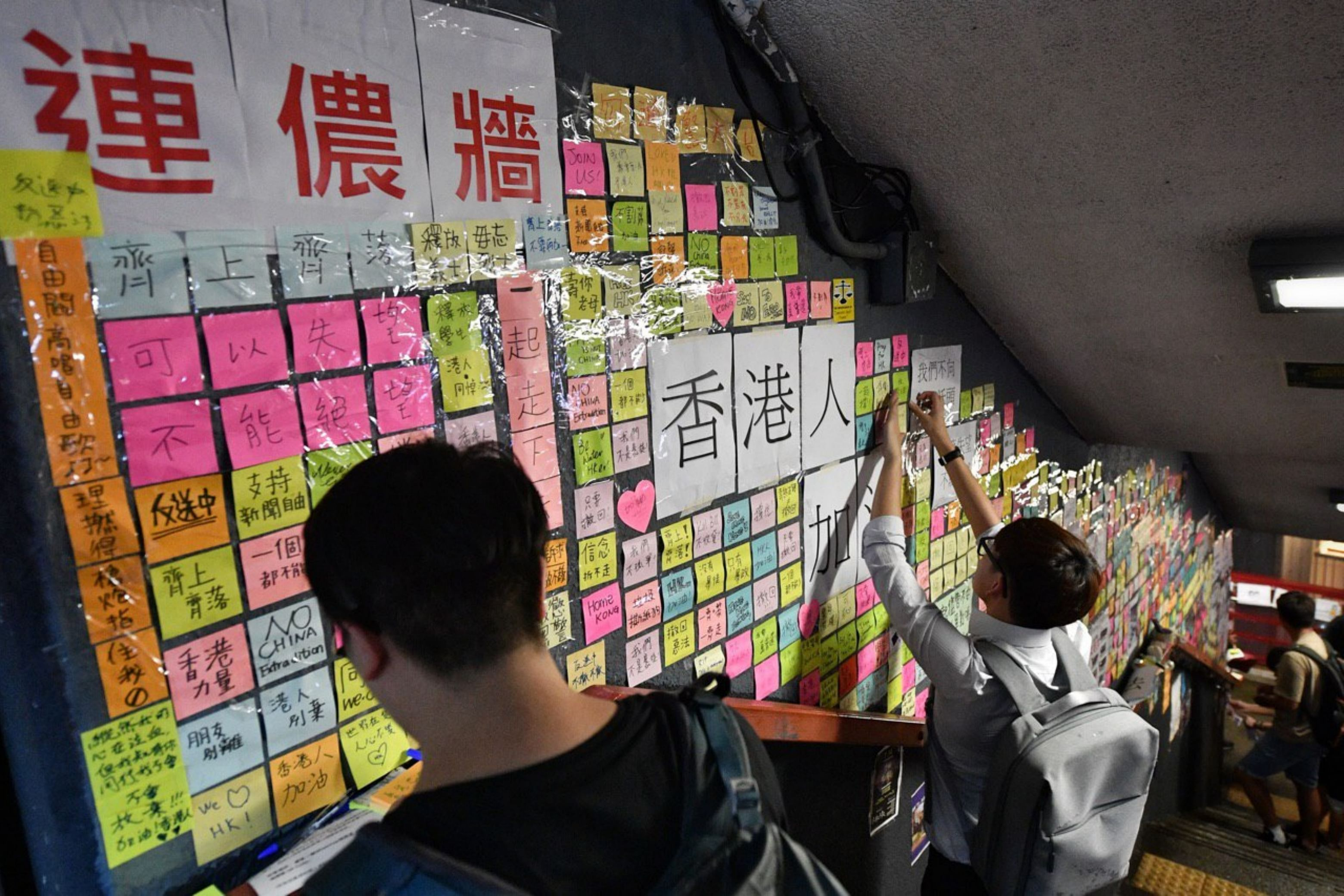 Hong Kong protesters march with mock coffin of city leader