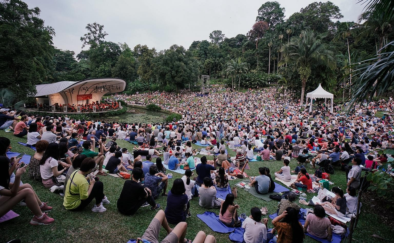 Music filled the air at the Botanic Gardens yesterday as the Singapore Symphony Orchestra (SSO) played to thousands who attended The Straits Times Concert in the Gardens. The SSO, led by associate conductor Joshua Tan, performed a selection of family