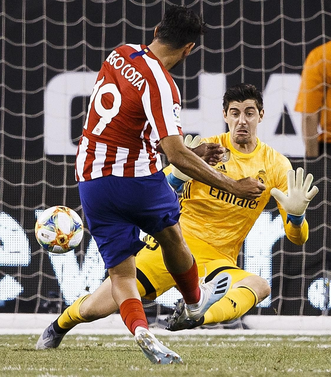Atletico Madrid striker Diego Costa scoring past Real Madrid goalkeeper Thibaut Courtois, his former teammate at Chelsea, during the International Champions Cup game in New Jersey on Friday. Atletico won 7-3.