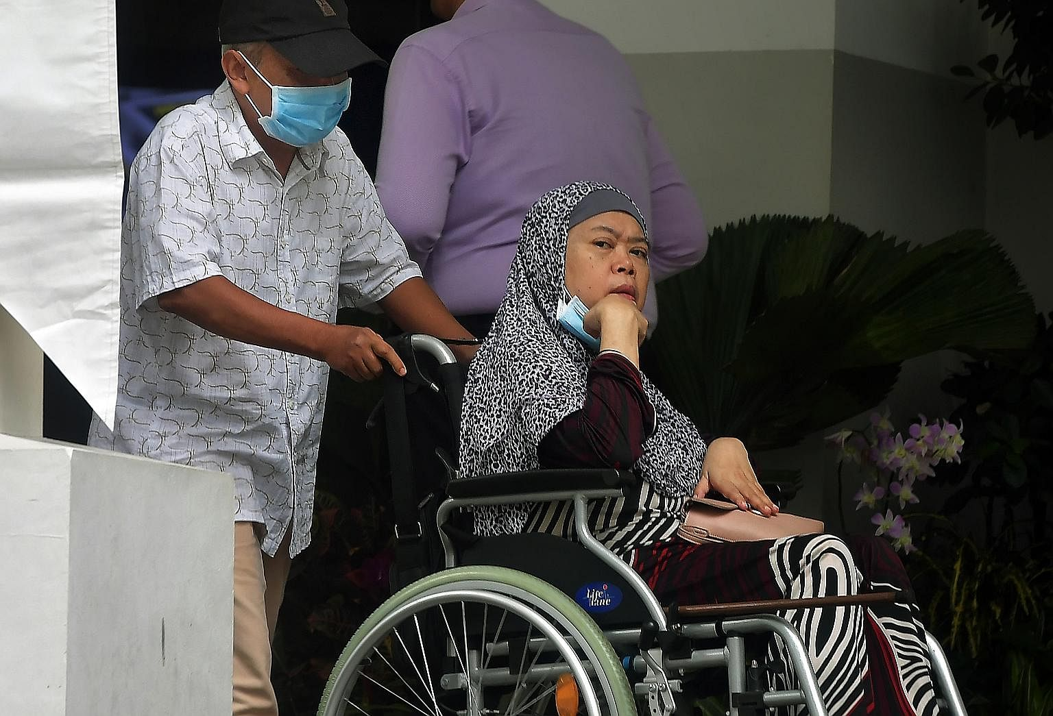 Zariah Mohd Ali and her husband Mohamad Dahlan, seen here leaving the State Courts on Tuesday, were dealt with in court yesterday for abusing their maid. 	Zariah, 58, who used items such as a hammer and stone pestle to hit her Indonesian maid, causin