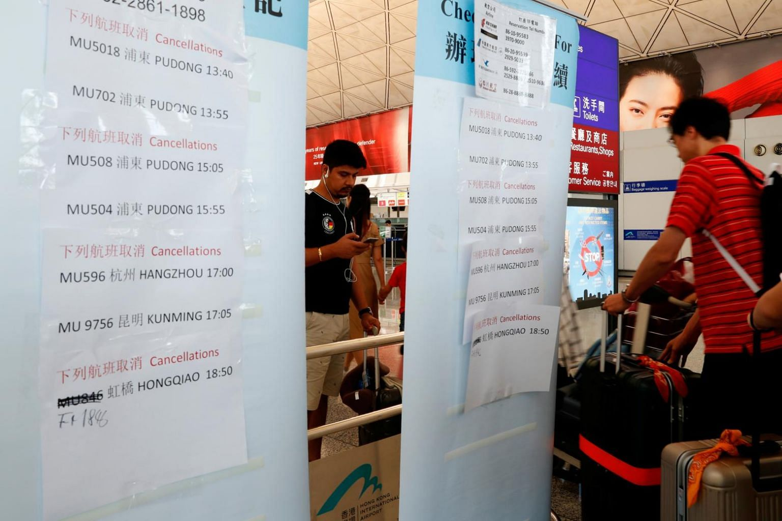 Flights cancelled, train services disrupted as Hong Kong
