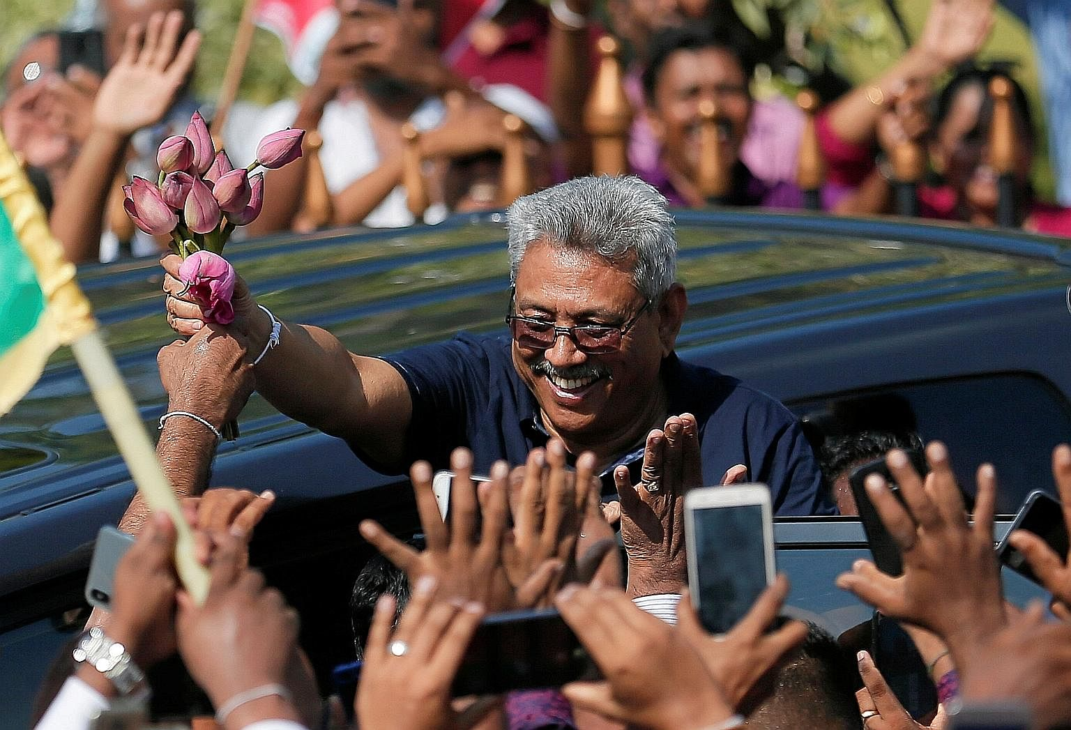 Sri Lanka's former defence secretary Gotabaya Rajapaksa waving to supporters. He is facing lawsuits in the US for allegedly instigating and authorising the extrajudicial killing of a journalist and war crimes against Tamils.