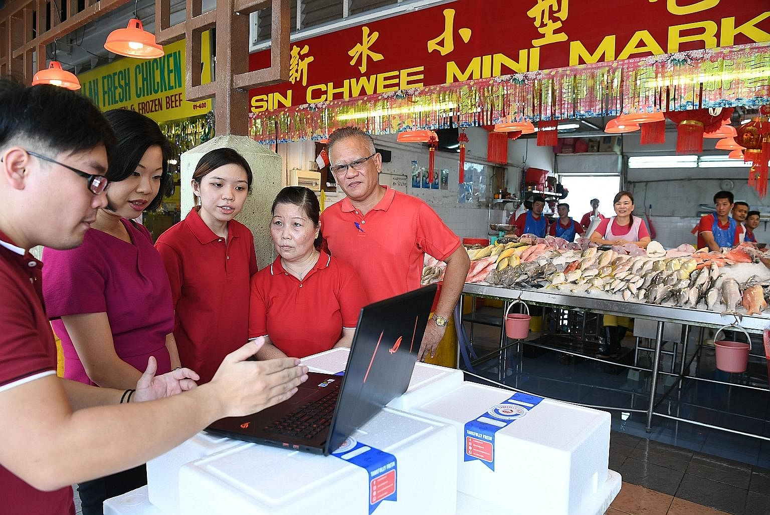 Since 1990, Sin Chwee Mini Market has been selling fresh seafood from its store in Bukit Gombak, but in a bid to reel in younger customers, its owners have digitalised their business. Yesterday, Mr Jimmy Goh (left), owner of its e-commerce arm Tankfu