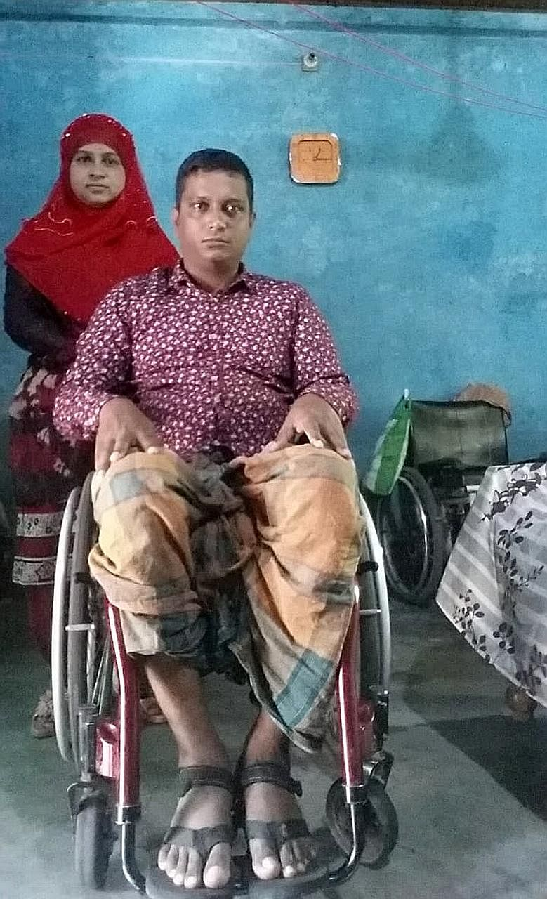 Mr Md Suzon Miah Md Abdul Razak, seen here with his wife Habiba Khatun, became wheelchair-bound after the accident in 2015.