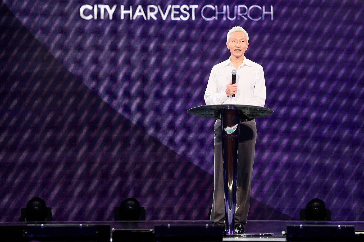 City Harvest Church founder Kong Hee speaking to the congregation yesterday, in his first service at the church since his release from jail on Thursday.