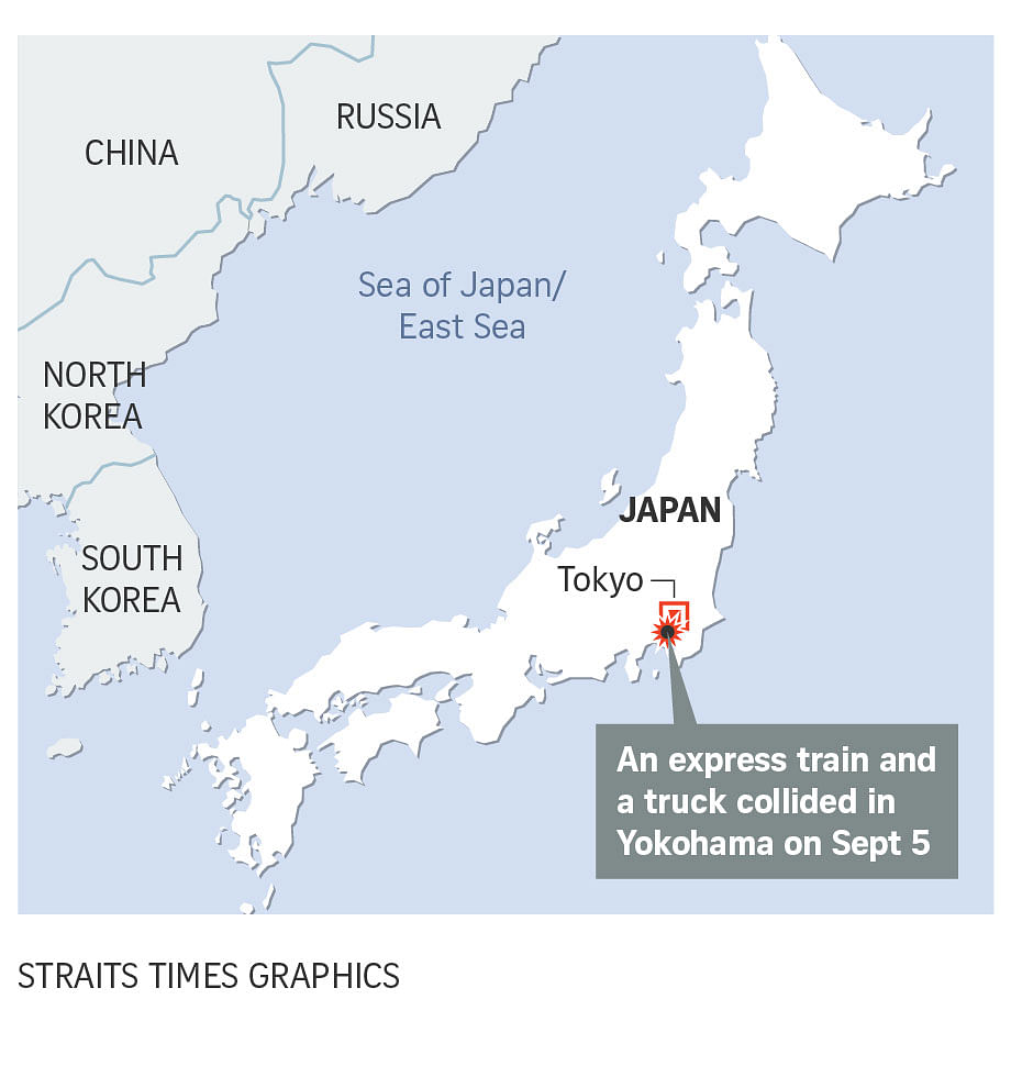 One dead, 30 injured as train and truck collide in Japan's