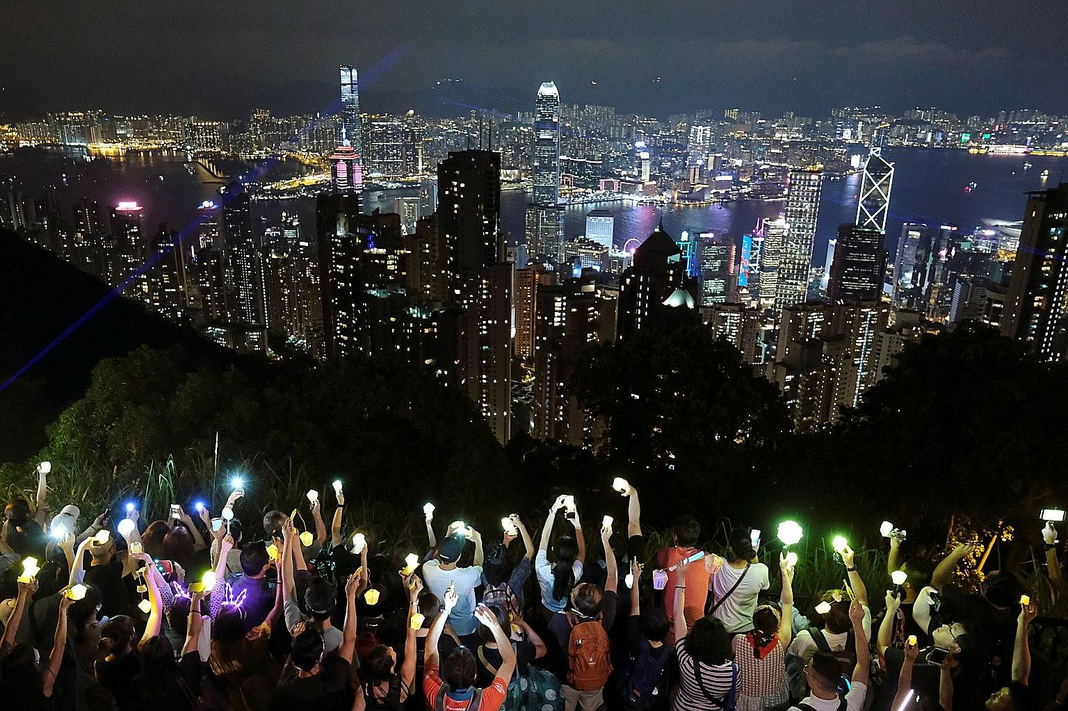 Hong Kong pro-democracy protesters took to the hills, including Victoria Peak, to form flashlight-carrying human chains last night, using the Mid-Autumn Festival as an occasion for their latest rally in more than three months of demonstrations that h