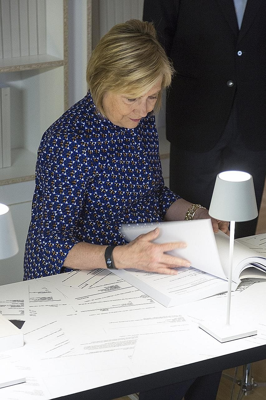 Mrs Hillary Clinton at US artist Kenneth Goldsmith's art exhibition dedicated to her e-mails in Italy this month. Her use of a private e-mail server during her term as secretary of state triggered multiple probes.