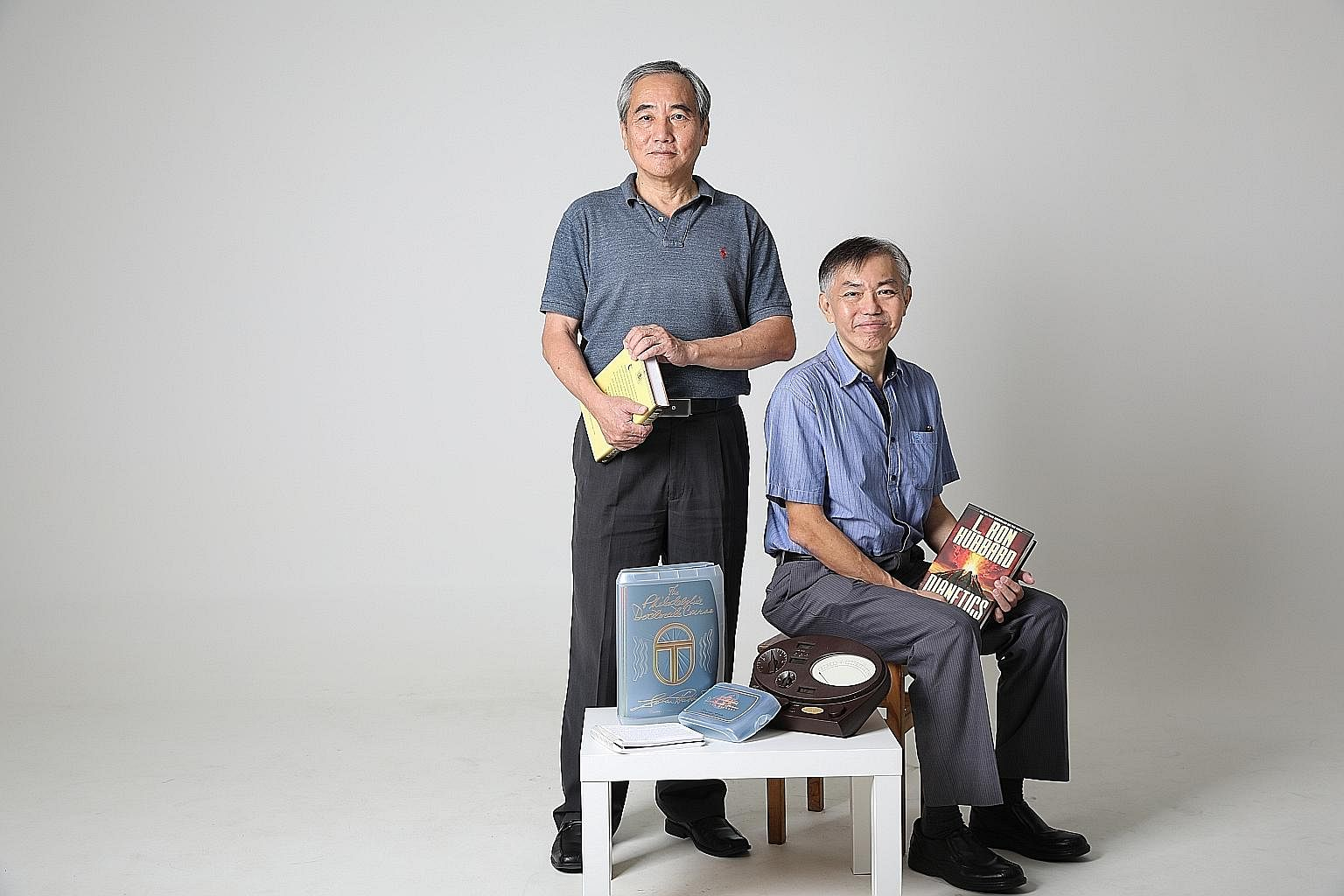 Mr Ong Eng Chowg (left) and brother Ong Eng Liang are among the few Scientologists in Singapore.