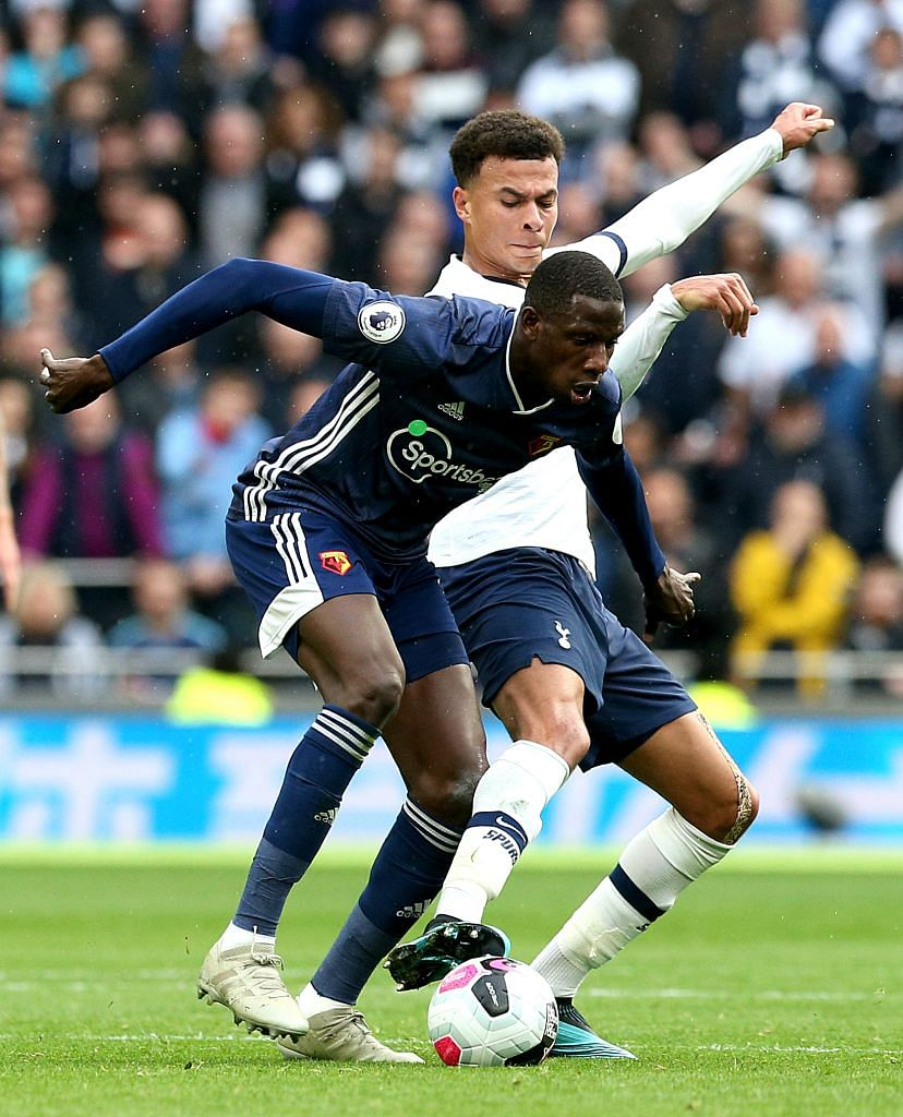 The two scorers, Dele Alli (in white) and Abdoulaye Doucoure, tussling for the ball. The Watford midfielder had got his side off to a flier in the sixth minute, before Alli equalised in the 86th minute to earn Tottenham a share of the spoils.