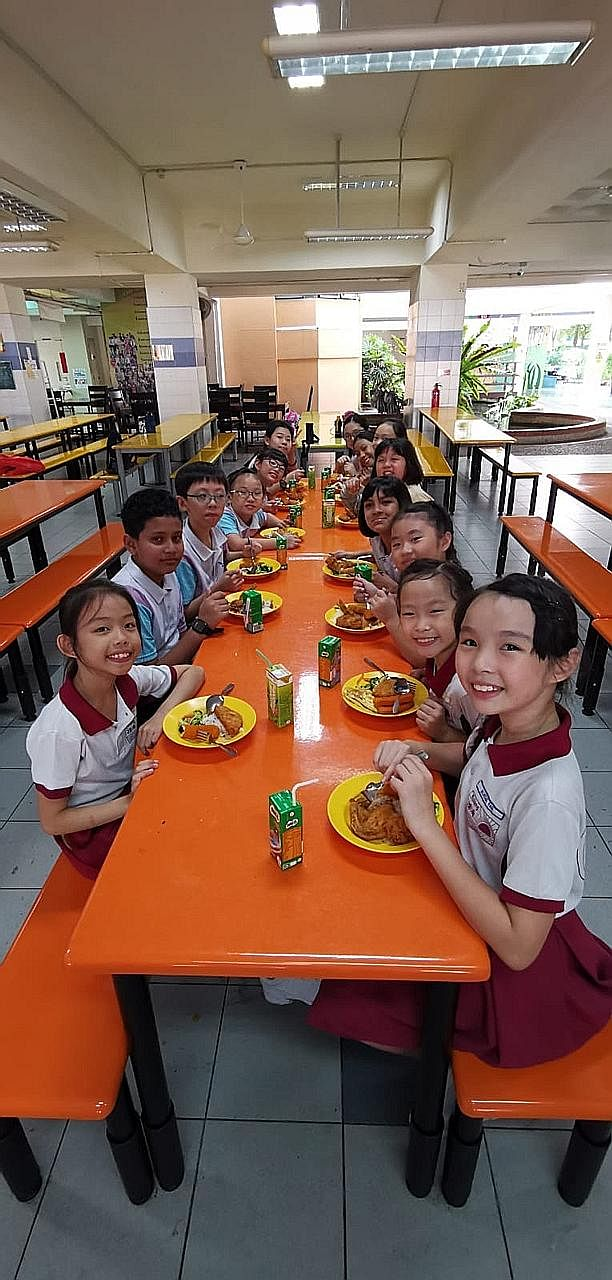 Pupils from Grace Orchard School and Rulang Primary School having lunch together before the start of their combined dance practice in July.