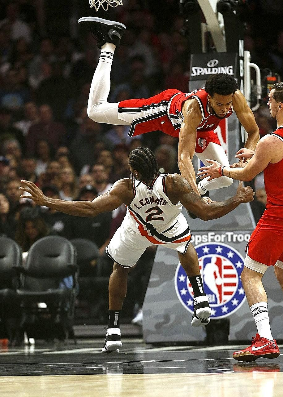 Portland Trail Blazers' Skal Labissiere impeding Kawhi Leonard of the Los Angeles Clippers illegally, during their game at the Staples Centre. Leonard recovered from being fouled to lead all scorers in an LA win.