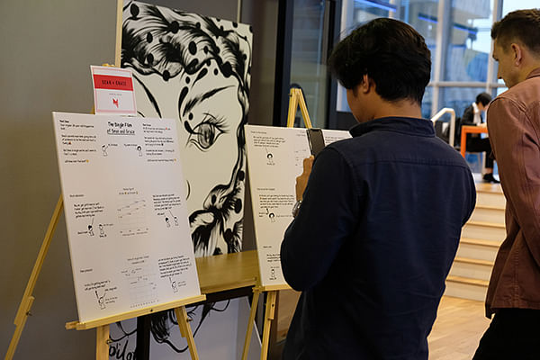 "Attendees at the prize giving ceremony view the winning work by Goh Wei Ping and Jamie Soo, entitled ""The single files of Sean & Grace"" on Nov 14, 2019."