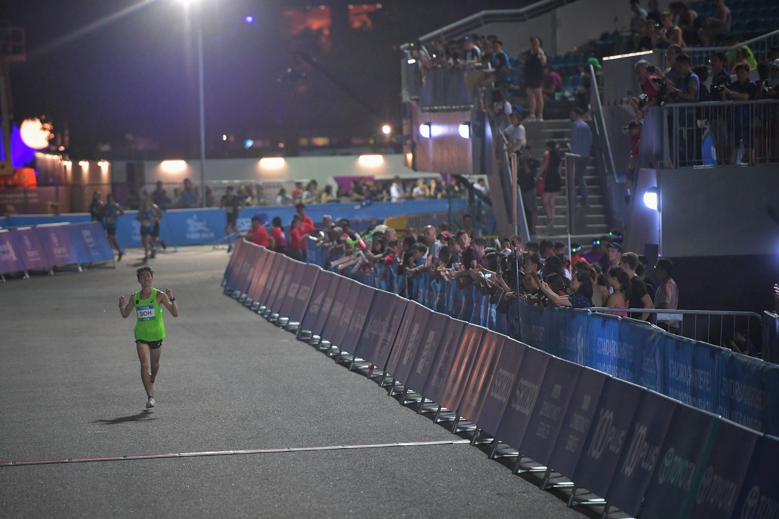 Soh Rui Yong finishing in 2hr 45min 52sec to complete his hat-trick of titles for local elite men.