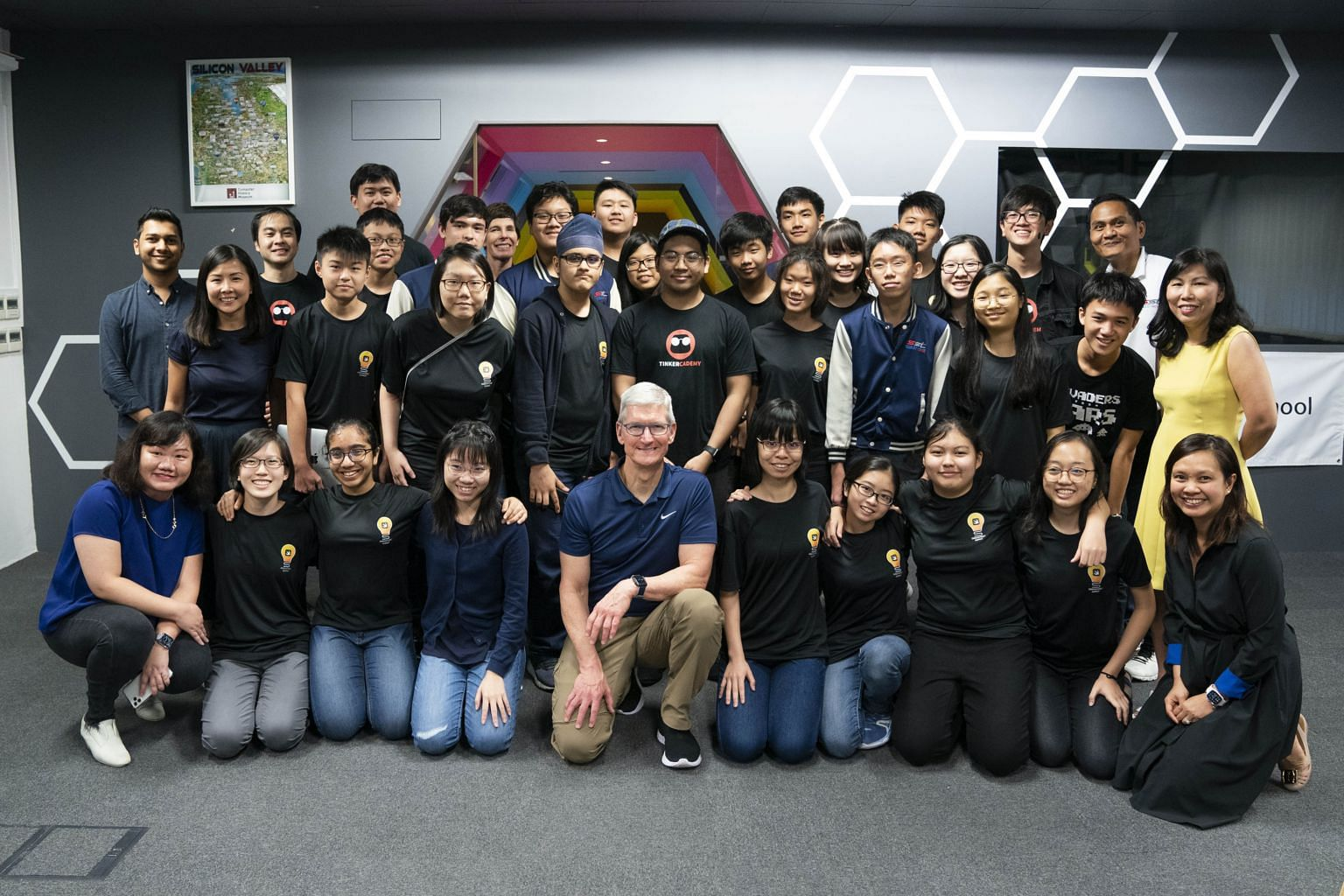 Apple chief executive Tim Cook with some of the 100 graduates of the Swift Accelerator programme on Dec 11, 2019.  PHOTO: APPLE