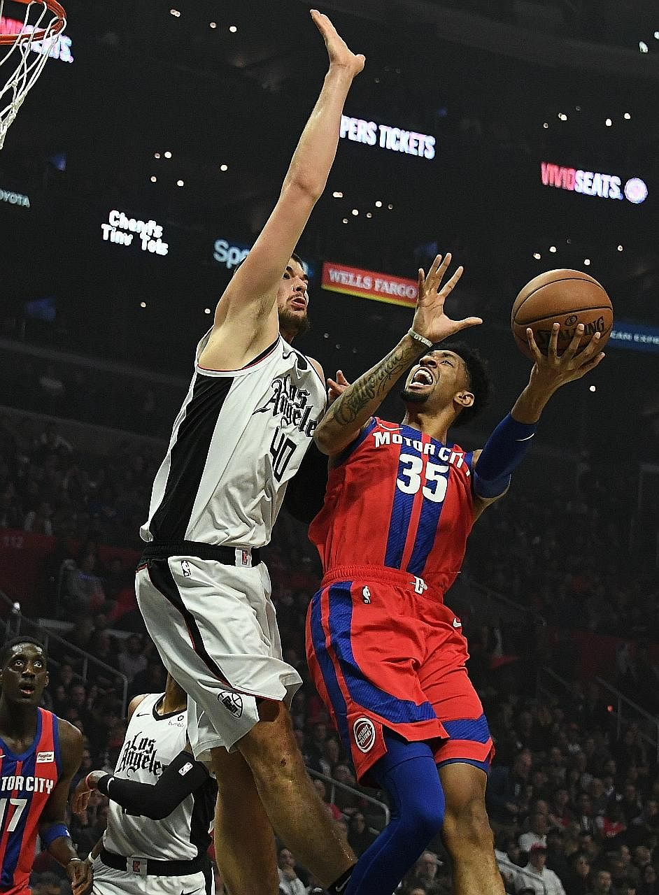 Clippers centre Ivica Zubac defending against Pistons forward Christian Wood in the first quarter at Staples Centre. The Clippers triumphed 126-112 for back-to-back wins for the first time since Dec 13, with reserves Montrezl Harrell and Lou Williams