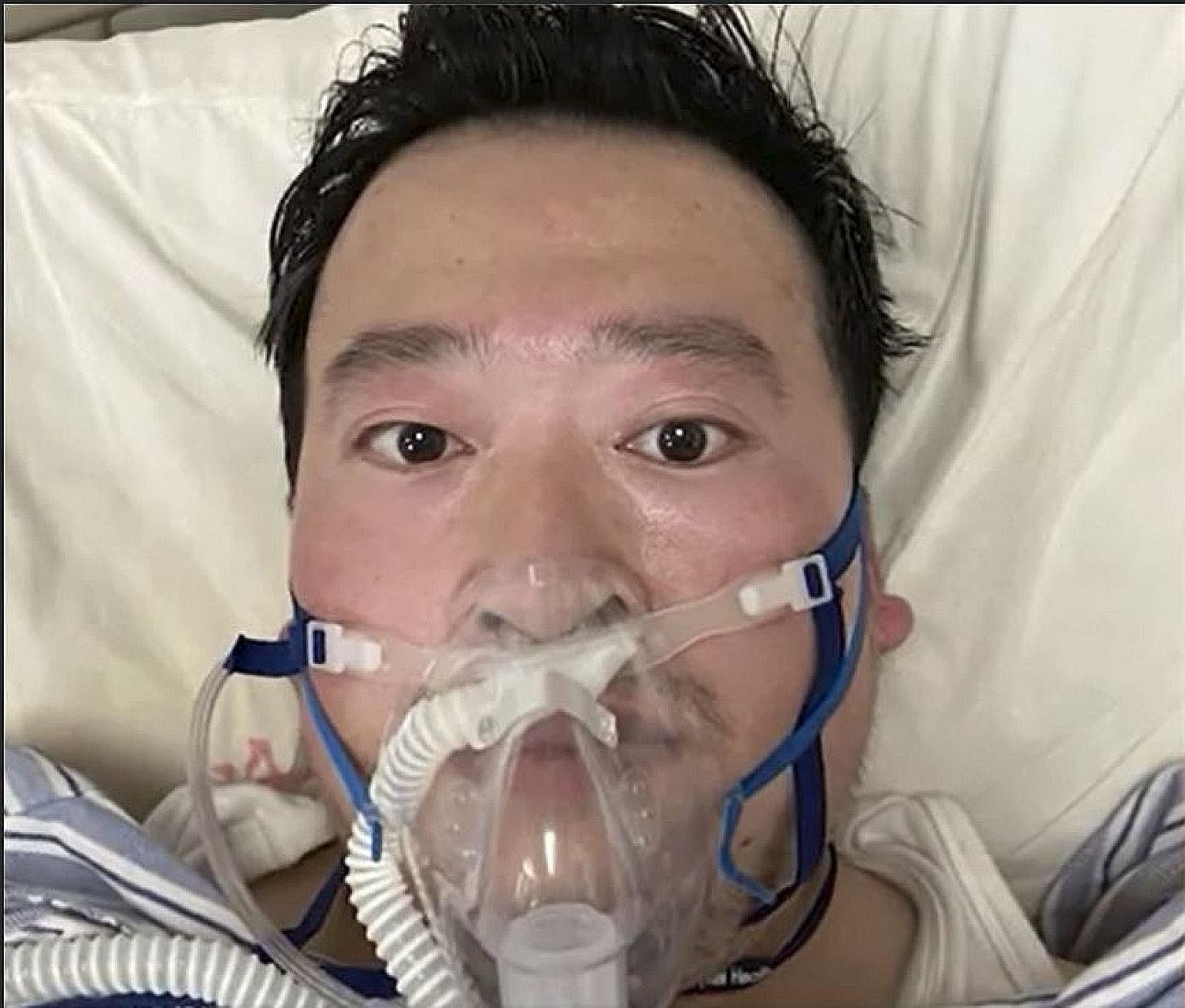 """Dr Li Wenliang at a hospital in Wuhan. He was reprimanded by Wuhan police last month for """"spreading rumours"""" about the coronavirus before it was officially recognised. News of his death sparked a public outcry."""