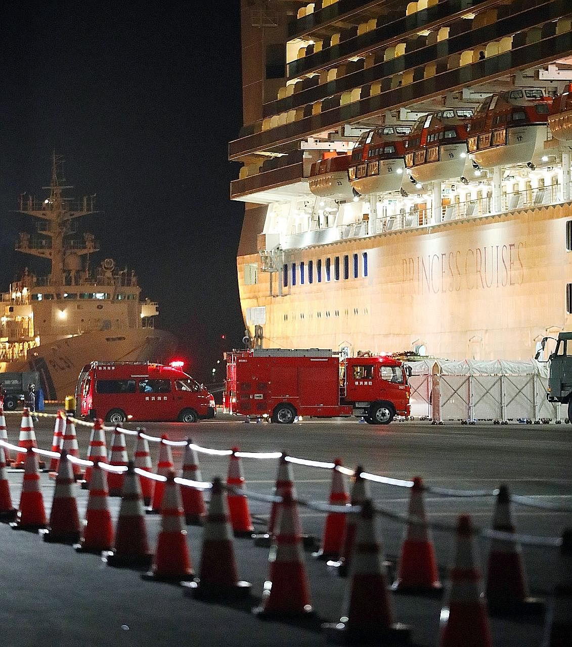Fire brigade vehicles arriving at the Daikoku Pier Cruise Terminal where the Diamond Princess cruise ship was docked in Yokohama, south of Tokyo, yesterday. The ship, which arrived off Japan's coast early last week, is expected to stay in quarantine