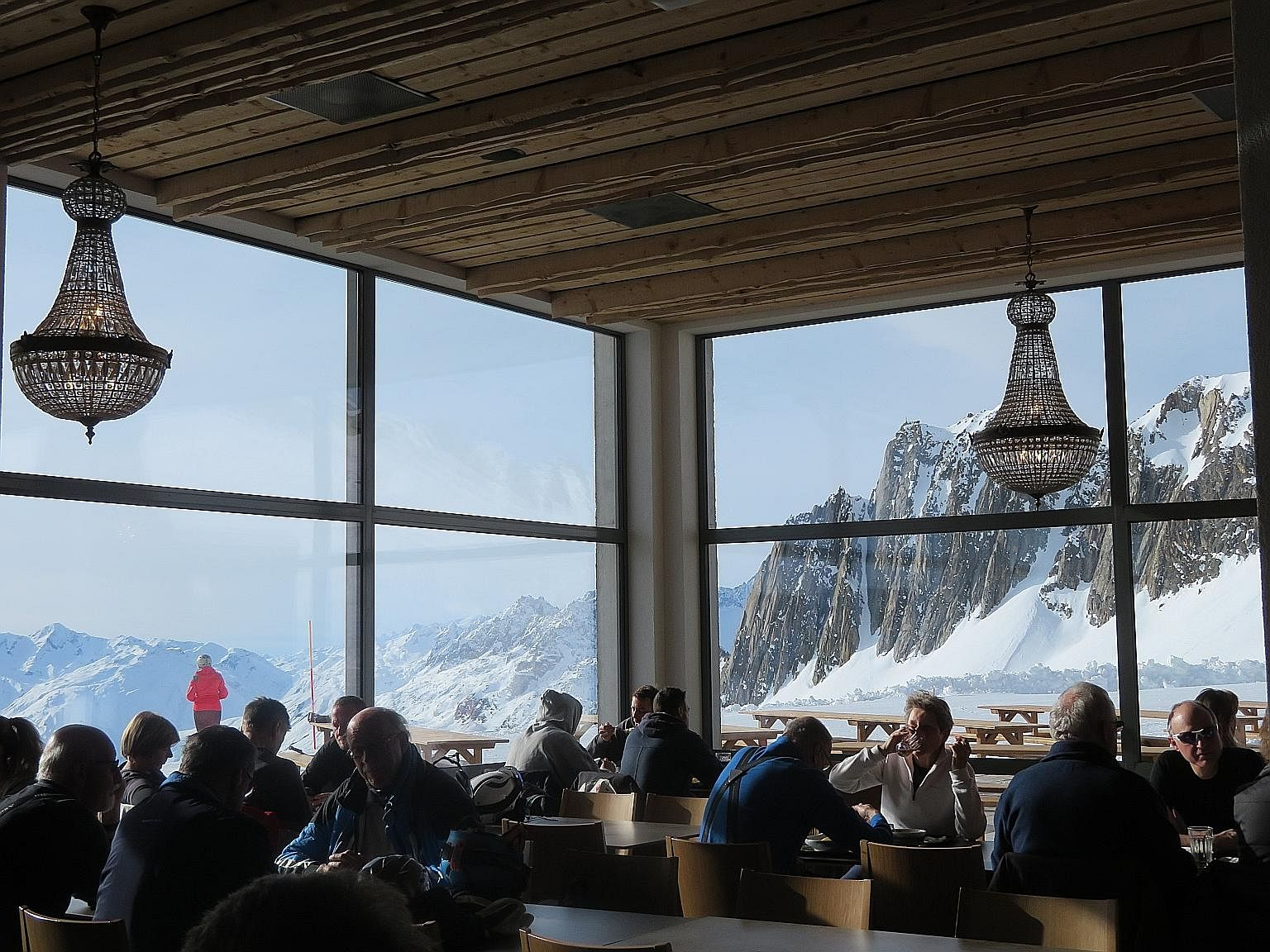 An eatery at Schneehuenerstock, where visitors can dine with a view of the sprawling Swiss Alps outside.