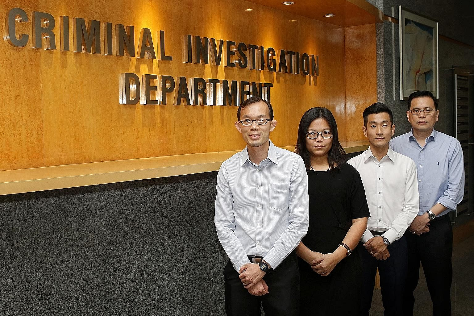 (From left) 2 Deputy Director Criminal Investigation Department (CID) and Senior Assistant Commissioner of Police Lian Ghim Hua