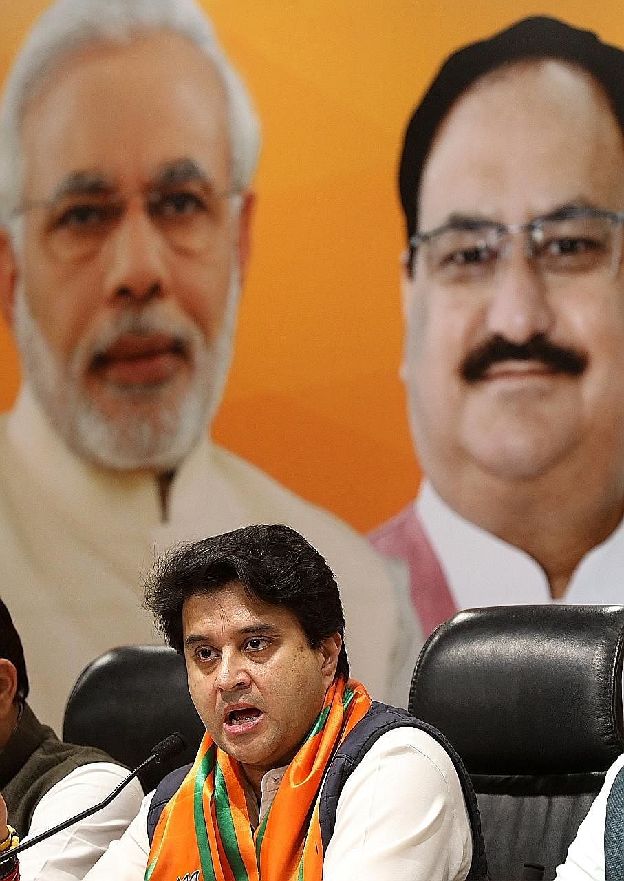 Former senior Congress leader Jyotiraditya Scindia speaking to reporters at the Bharatiya Janata Party office in New Delhi yesterday. Mr Scindia is said to have been unhappy over not being chosen as Madhya Pradesh chief minister by the Congress party
