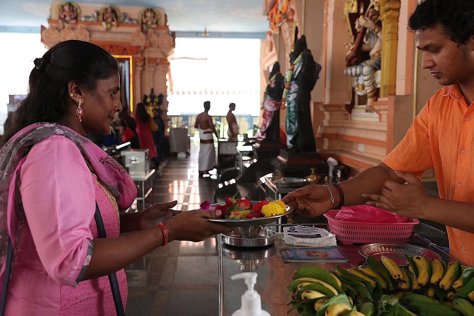 Prasadham, food and flowers that have been blessed, are given to devotees on platters, instead of by hand, to avoid unnecessary contact at Sri Darma Muneeswaran Temple.
