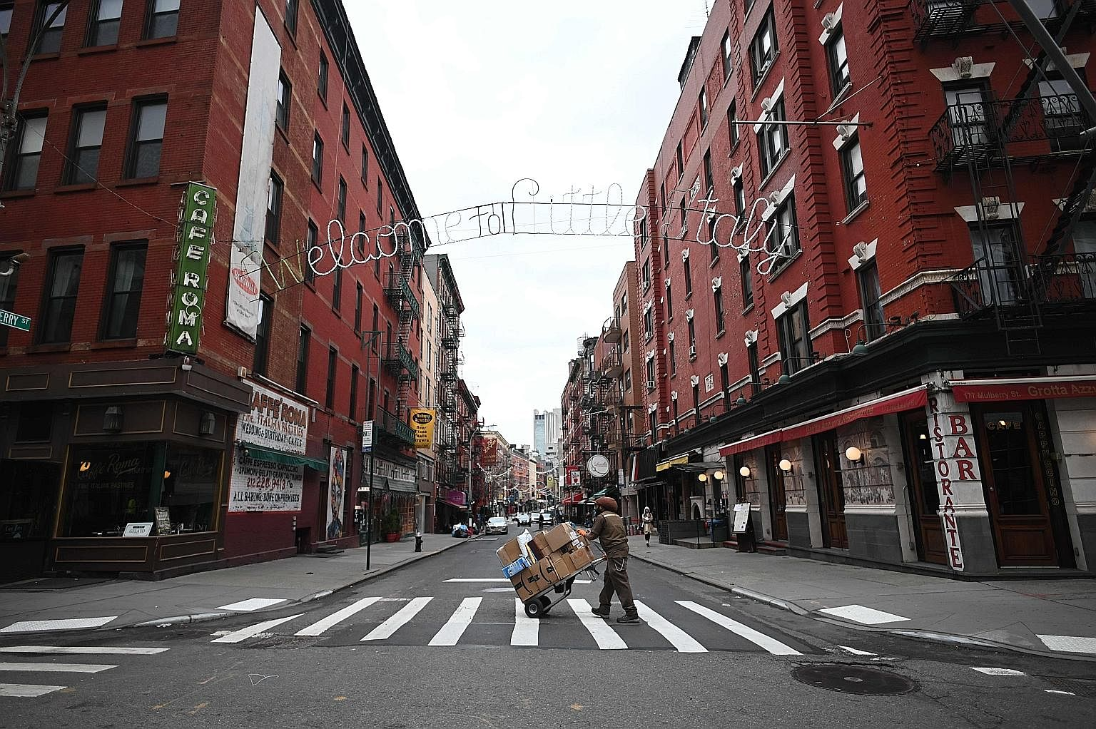 Closed shops and restaurants seen in Manhattan's Little Italy last week in New York City. The coronavirus outbreak has transformed the United States virtually overnight from a place of boundless consumerism to one suddenly constrained by nesting and