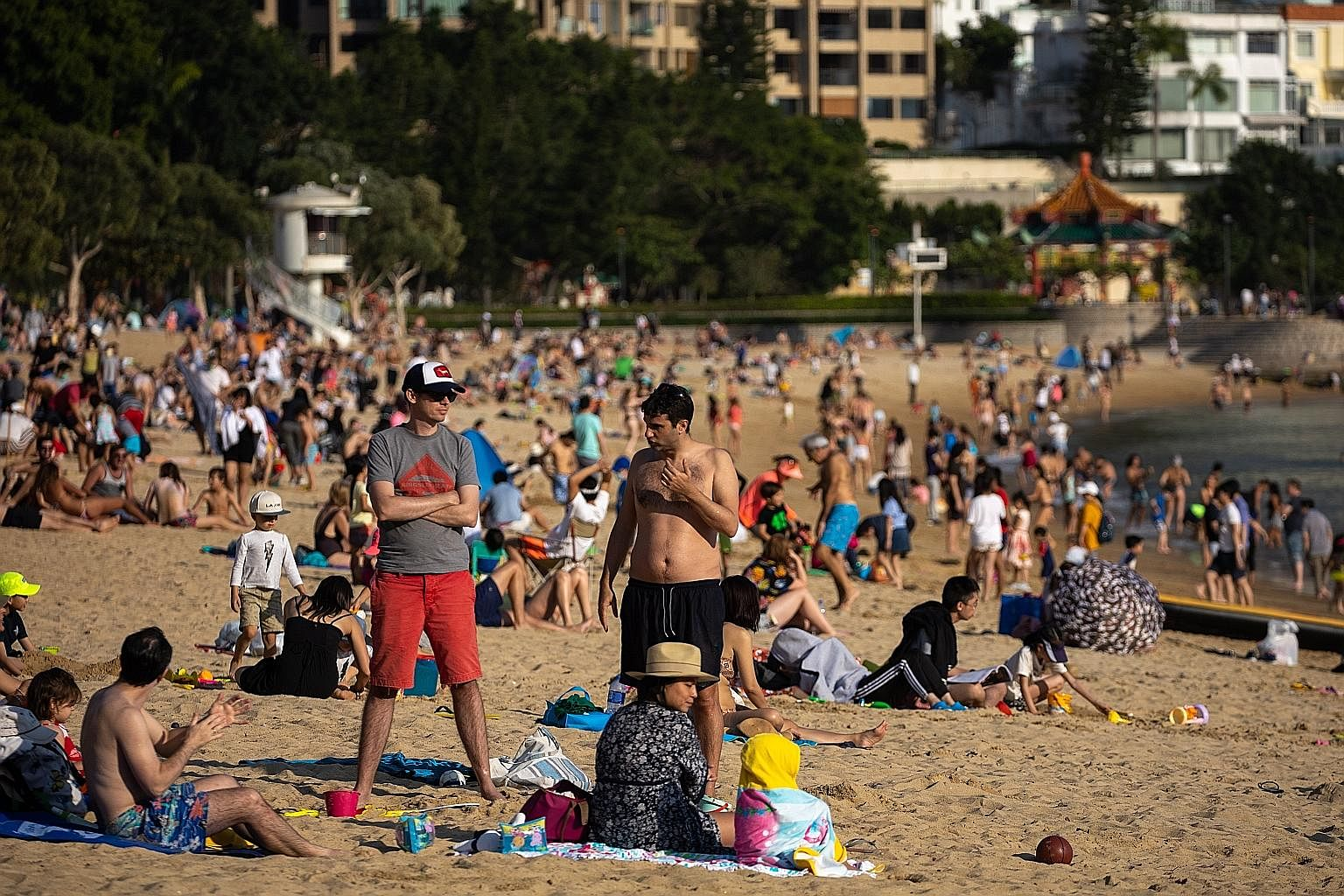 People crowding Repulse Bay beach in Hong Kong on Sunday. Countries and territories such as South Korea, Hong Kong and Taiwan prioritised different strategies, relying on rigorous contact tracing, widespread testing and early quarantining of all high
