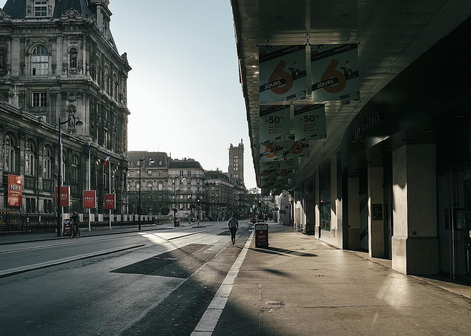 An empty street in Paris on Monday. One answer is not to abandon the lockdowns before the death rate is brought under control, says the writer. It will be impossible to reopen economies with a raging epidemic, increasing numbers of dead and pushing h