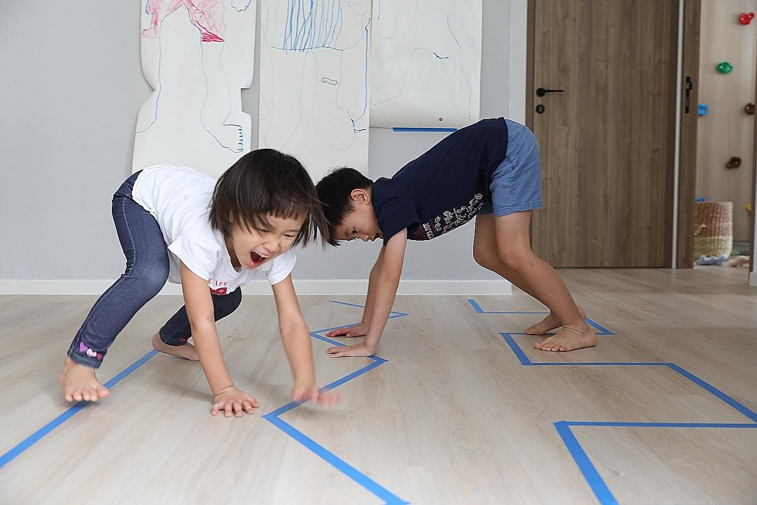 Parents can use items in the house to create activities for children, says Ms Fynn Sor, who runs an activity resource website called Happy Tot Shelf. Here, her children, Riley, four, and Zachary, seven, go through a line obstacle course where they tr