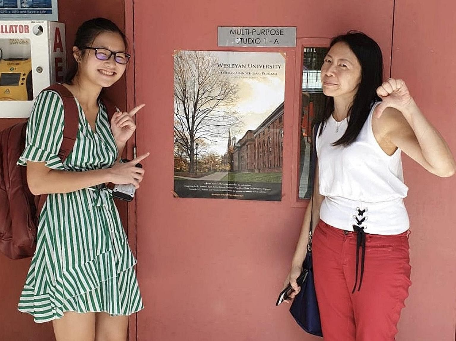Singaporean Andrea Ho, who has recently been accepted into Georgetown University, with her mother Shirley Tey, who is cautious about the teen going overseas before the pandemic is brought under control.