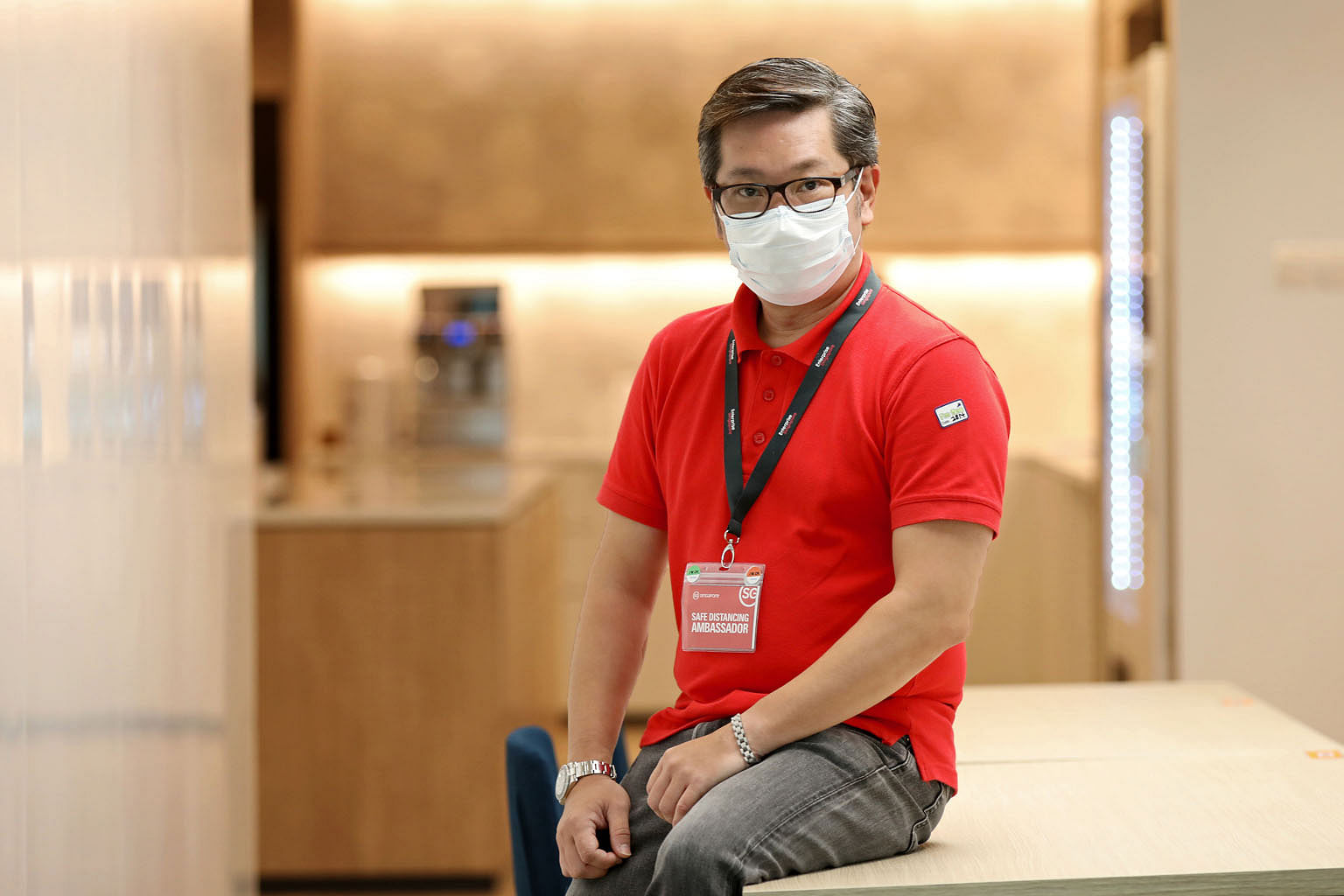 Mr Richard Lim, who works as a tour manager, signed up to be a safe distancing ambassador with Enterprise Singapore earlier this month, after the travel industry came to a halt. He now patrols Jurong Point mall five to six days a week.
