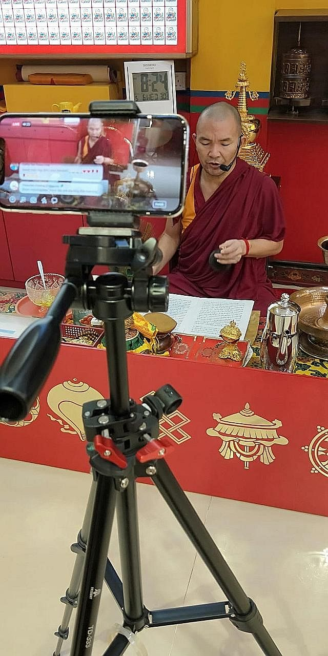 Lama Tenzin Phuntsog from Thekchen Choling (Singapore), a Tibetan Buddhist temple, during morning prayers livestreamed on Facebook. During the circuit breaker period, Buddhists have turned to online resources to practise their faith. The temple's dev