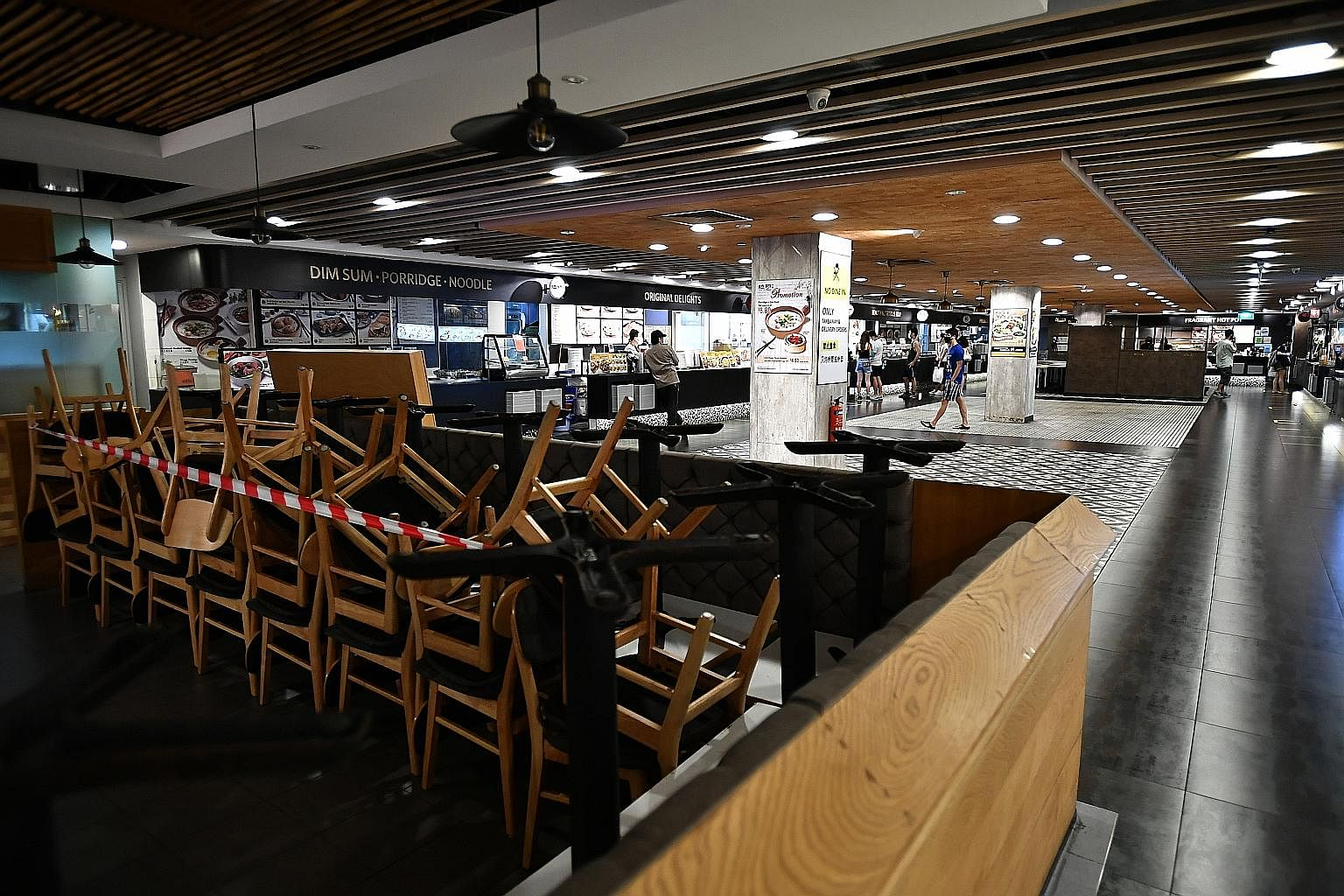 Tables and chairs stacked up in the foodcourt of Junction 8 mall on Tuesday, amid circuit breaker measures. Experts suggest dining-in at hawker centres, foodcourts or restaurants will not be allowed to resume so soon even when Singapore finally relax