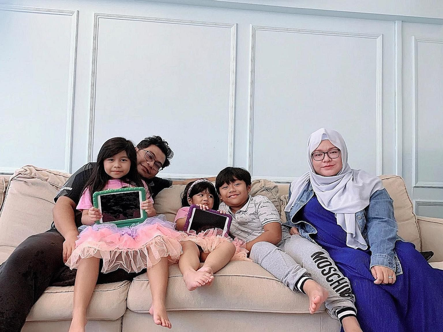 Ms Nur Hafizah Sulaiman's husband, Mr Mohammed Fariheen Mohamed Faroukh, whose work schedule is more flexible than hers, supervised their children's home-based learning recently, while she attended to work calls.