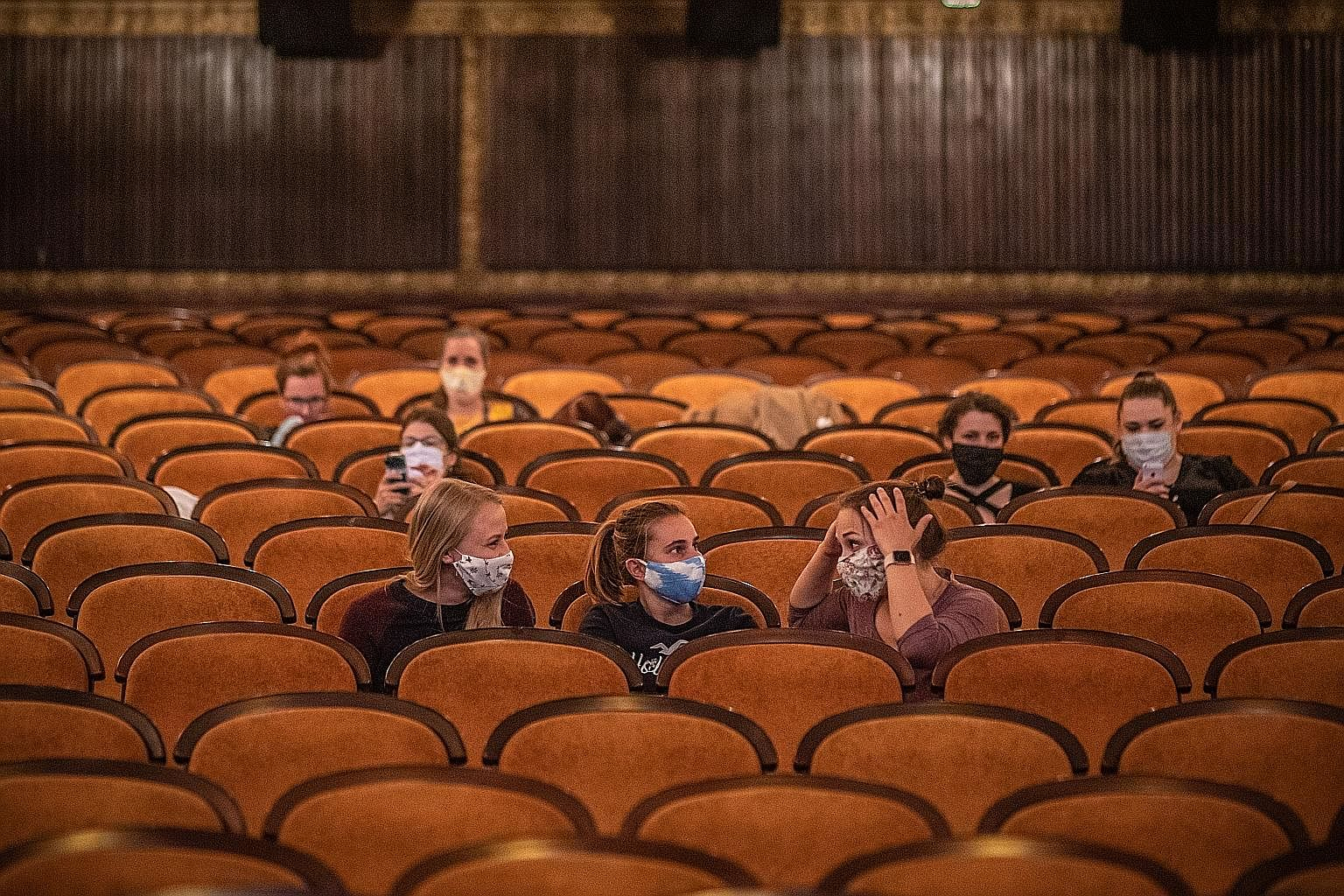 A handful of cinemagoers waiting for a movie screening in a reopened cinema in the centre of Prague last Monday. The Czech Republic allowed movie theatres across the country to operate again with attendance capped at 100 people.