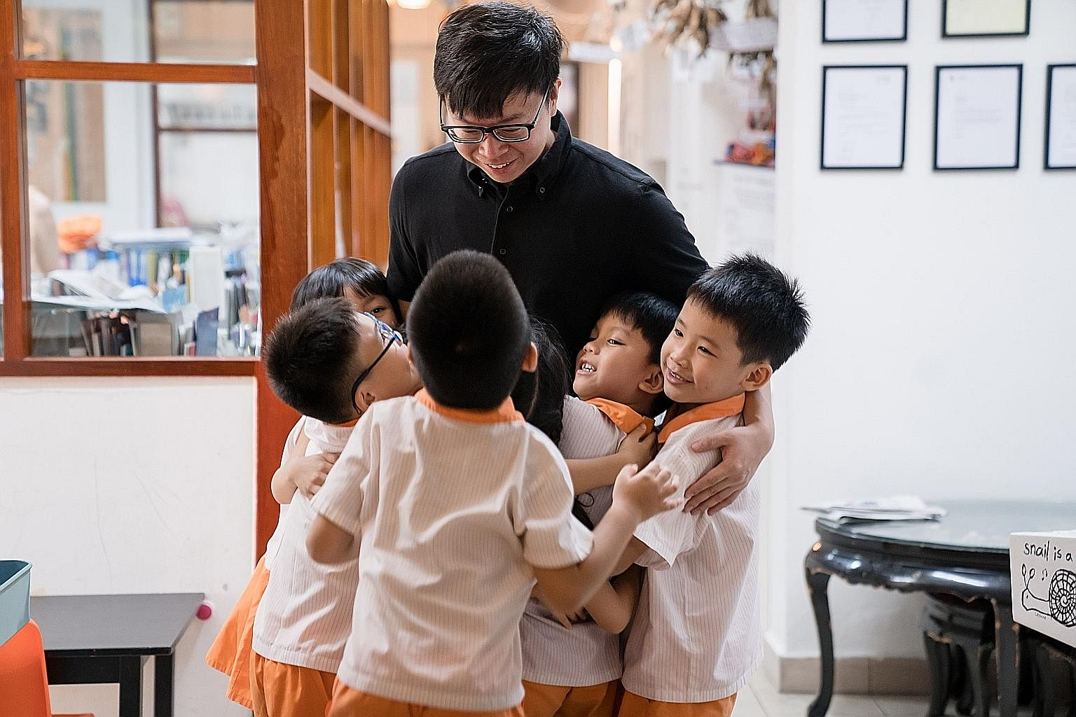 Singaporean conductor Wong Kah Chun with pupils from non-profit education centre Child at Street 11, as part of Project Infinitude, which aims to enrich the children's lives with music.