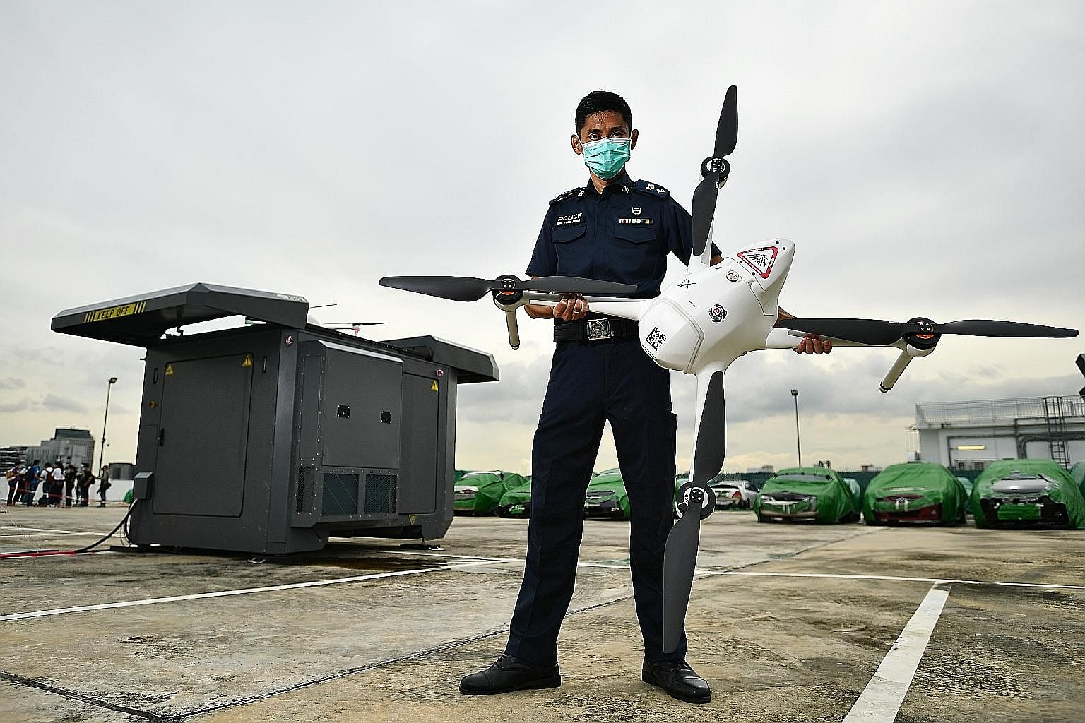 Deputy Superintendent of Police Sum Teck Meng, who is in charge of the Home Team Unmanned Aerial Vehicles unit, with the drone and drone box last Wednesday. Two such drone boxes are on trial and each drone is about 1.79m wide and weighs about 10kg. H