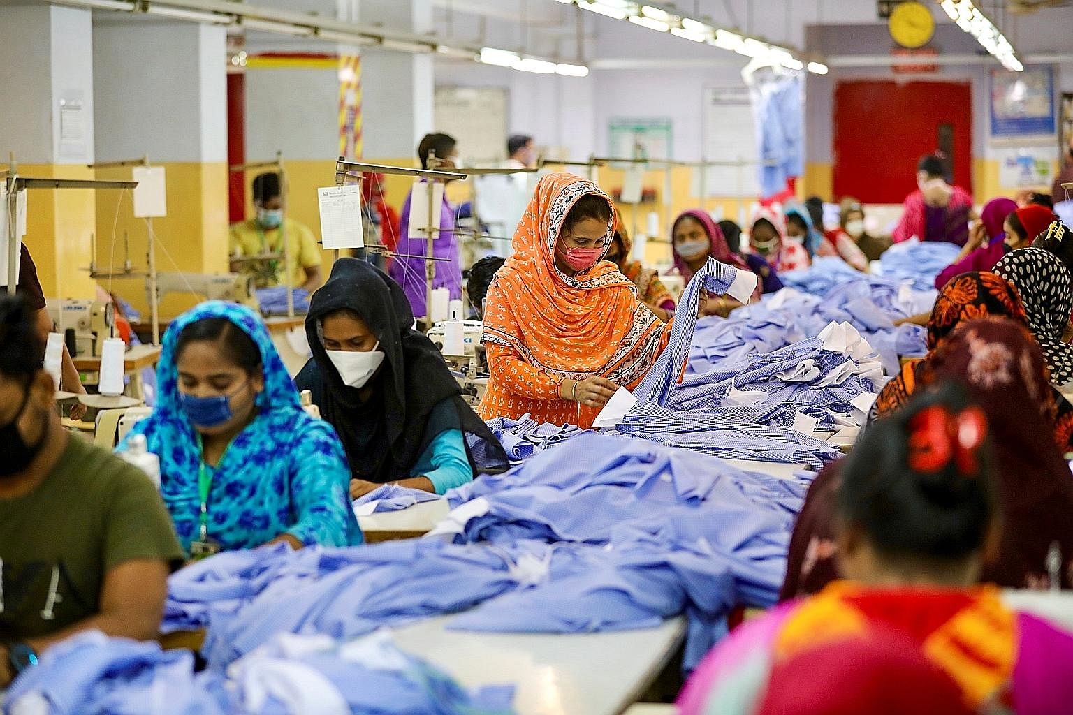 Women at work in a garment factory in Dhaka early this month. Bangladesh is the second-largest exporter of garments in the world. Its clothing manufacturers have, since the coronavirus crisis began, lost out on more than US$3 billion (S$4.3 billion)