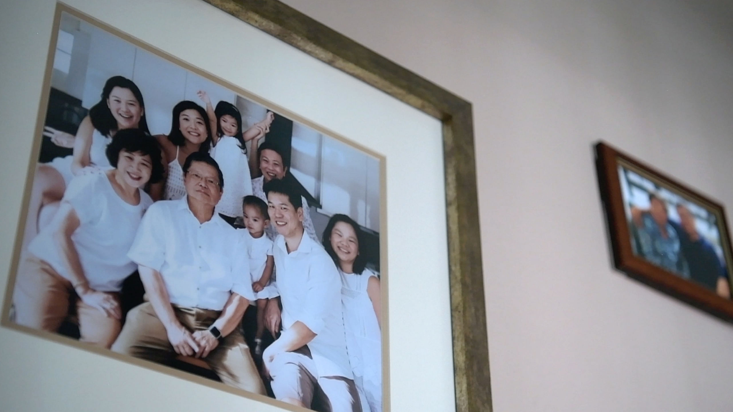 A family photo on the wall at Steven's home. The family decided to take photographs together when Steven was diagnosed.