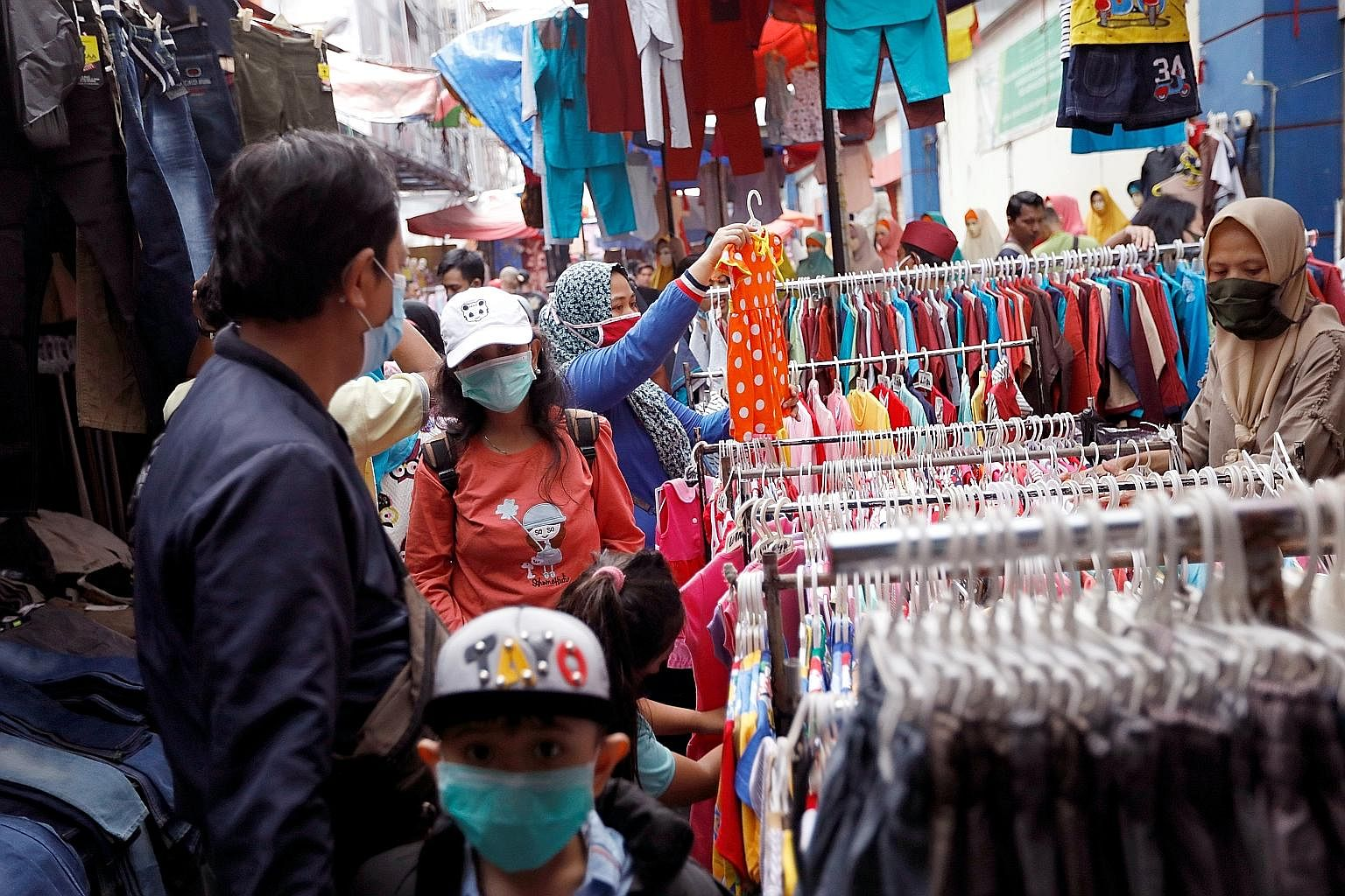 Tanah Abang market (above) in central Jakarta is among many that have been teeming with shoppers ahead of Hari Raya Aidilfitri on Sunday.