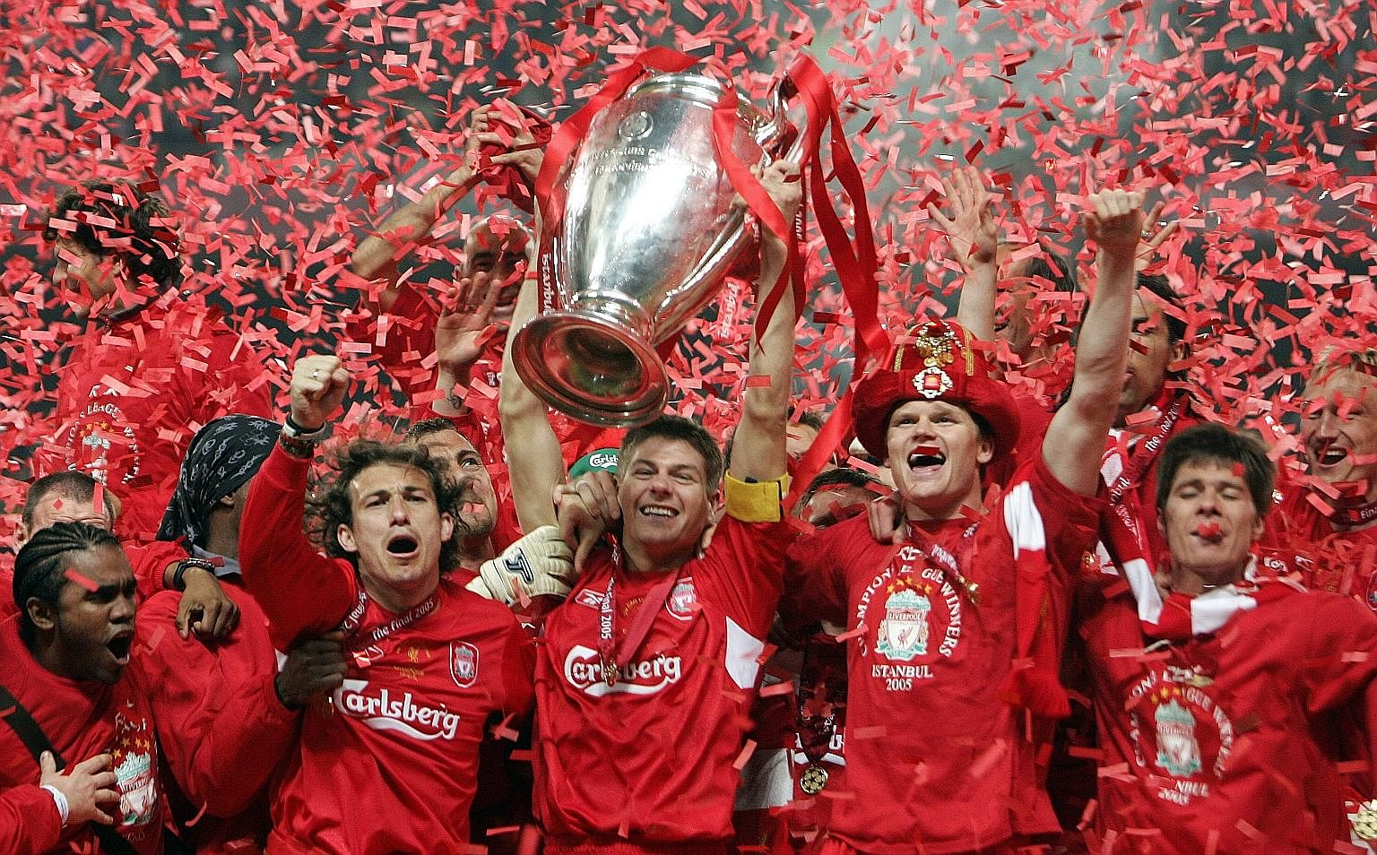 Liverpool's captain Steven Gerrard (holding the trophy) and his jubilant teammates on May 25, 2005, at the end of the Uefa Champions League football final at the Ataturk Stadium in Istanbul, where Liverpool beat AC Milan in dramatic fashion. Reunited