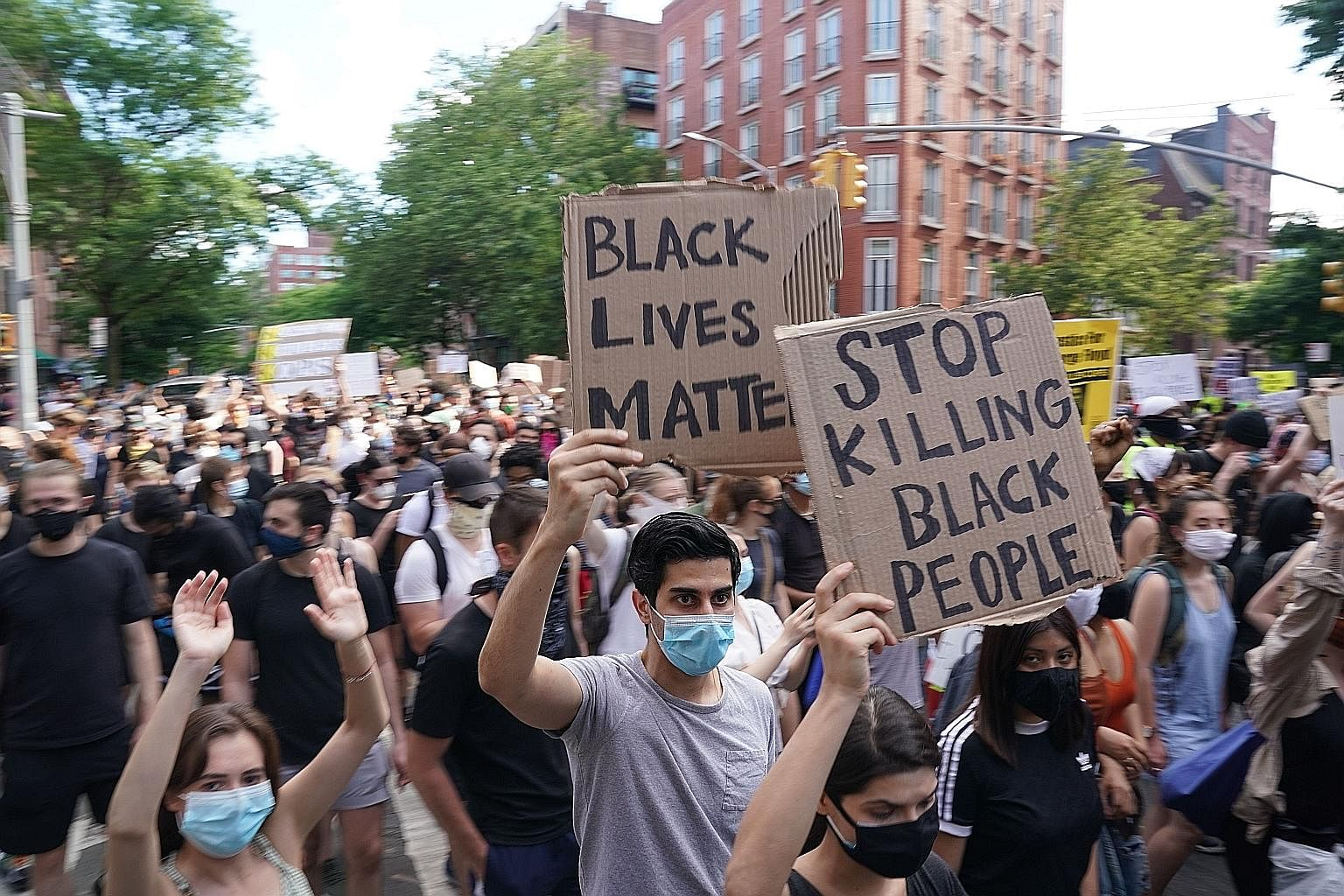 Demonstrators marching in New York City on Saturday as protests continued across the United States over the death of Mr George Floyd in Minneapolis, Minnesota. The African-American man was shown on video pleading that he could not breathe as a white