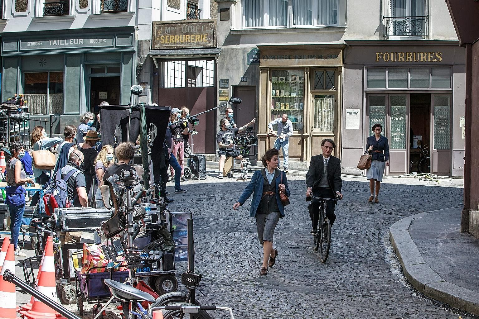 EPA-EFE Shooting of a film resumed in the Montmartre district of Paris yesterday as France lifted many of its l